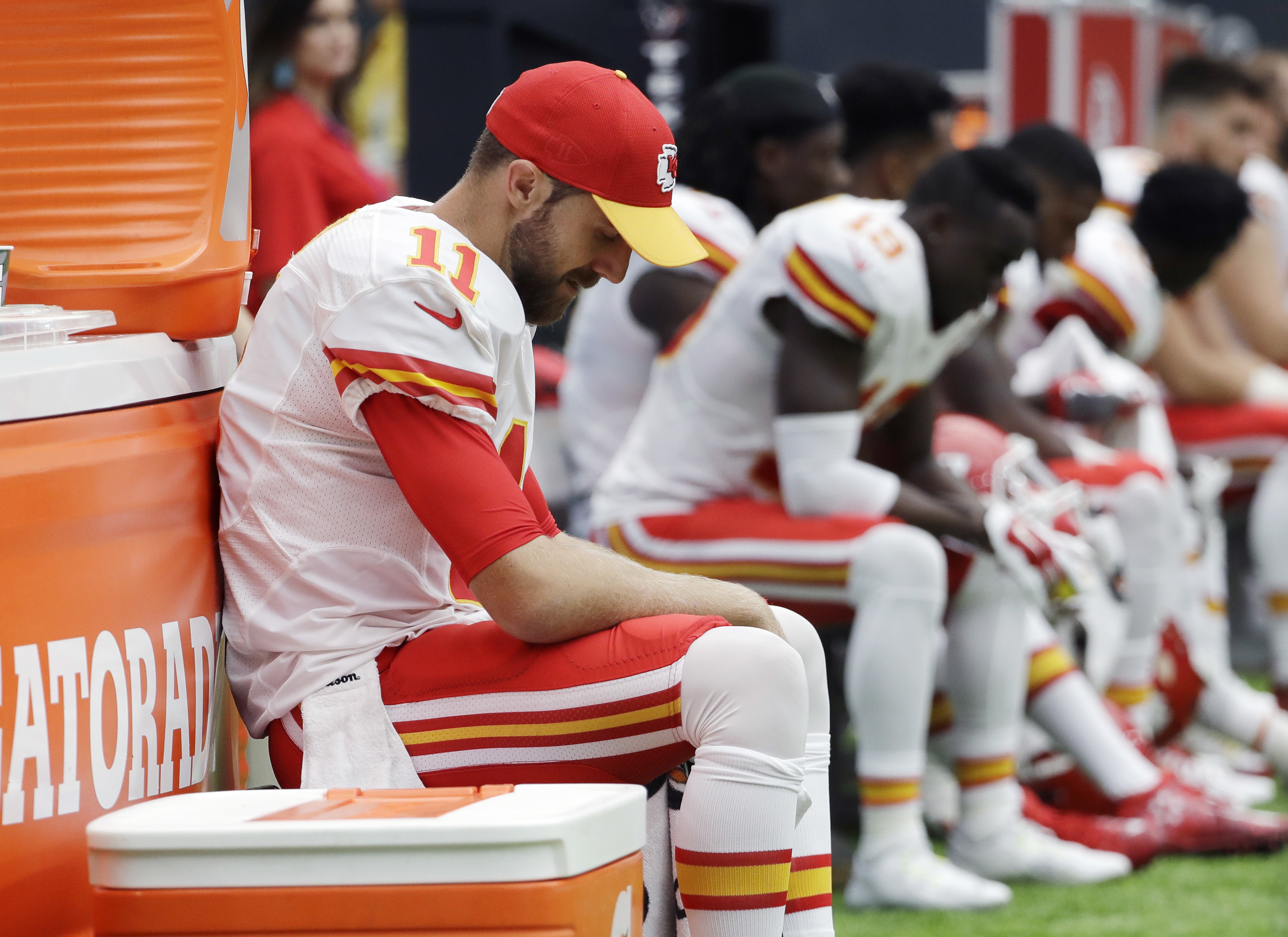 FILE - In this Sept. 18, 2016, file photo, Kansas City Chiefs quarterback Alex Smith (11) sits on the sideline during the second half of an NFL football game against the Houston Texans, in Houston. The Chiefs couldnt get out of their own way in a frustrat