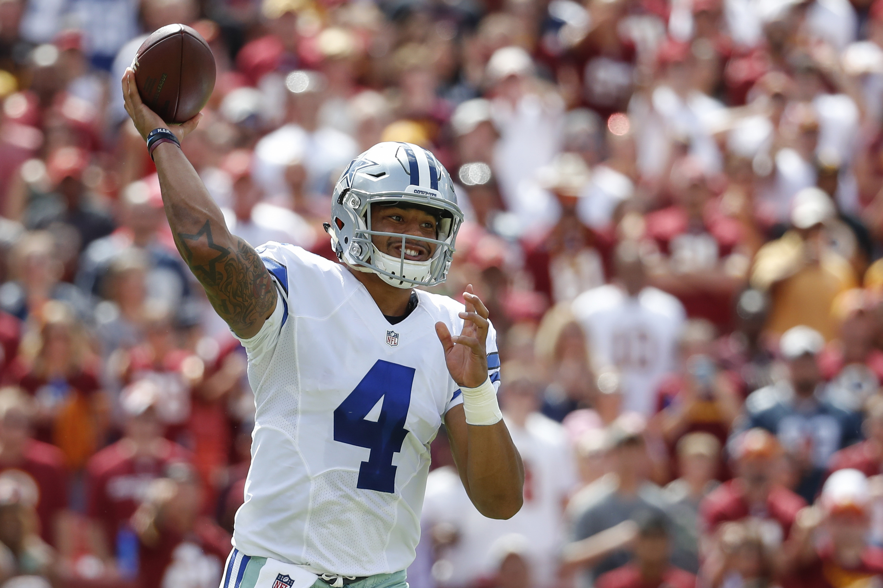 FILE - In this Sunday, Sept. 18, 2016 file photo, Dallas Cowboys quarterback Dak Prescott (4) passes the ball during the first half of an NFL football game against the Washington Redskins in Landover, Md. Prescott has said all along he felt ready for the