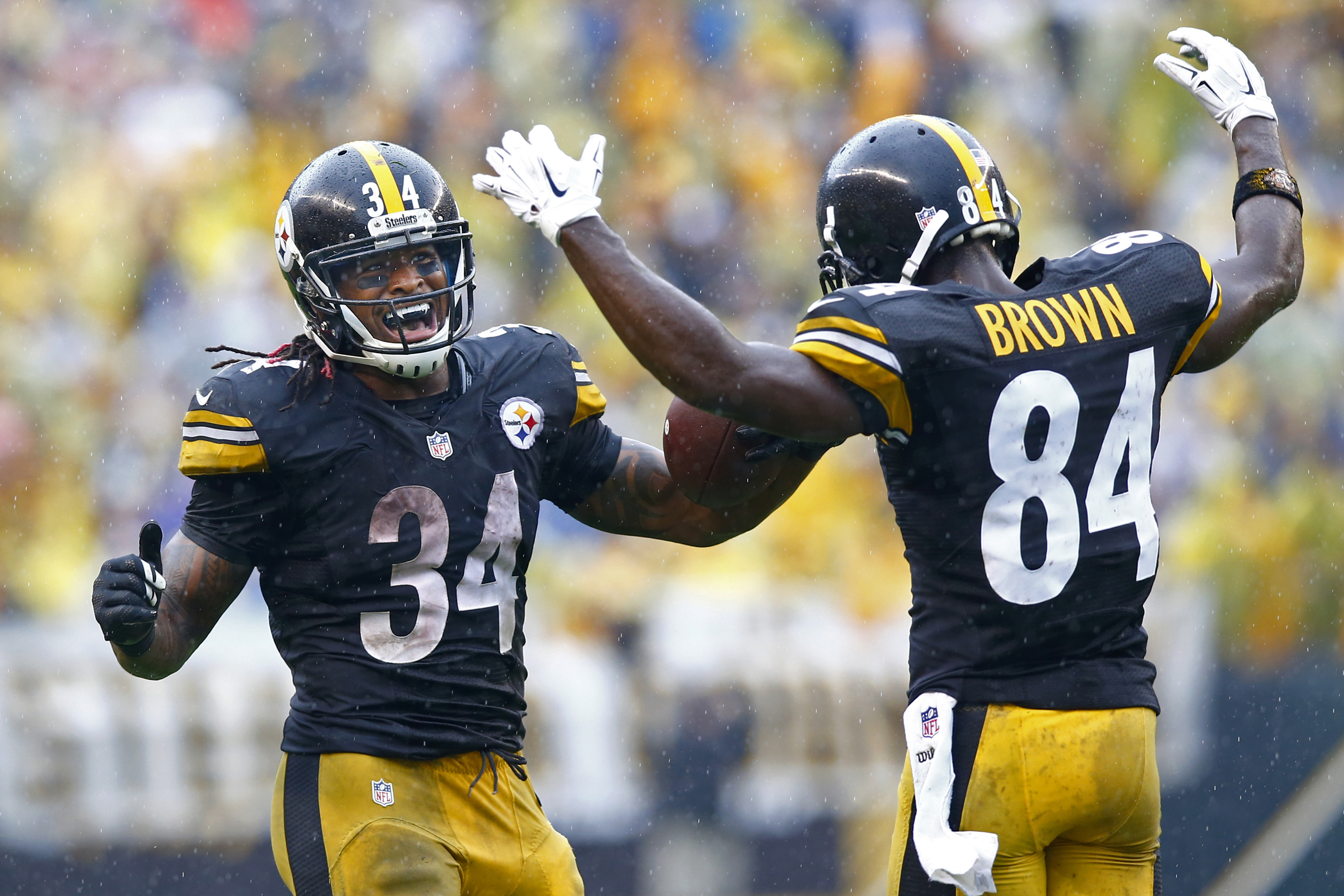 FILE - In this Sunday, Sept. 18, 2016, file photo, Pittsburgh Steelers running back DeAngelo Williams (34) celebrates his touchdown with wide receiver Antonio Brown (84) during the second half of an NFL football game against the Cincinnati Bengals in Pitt