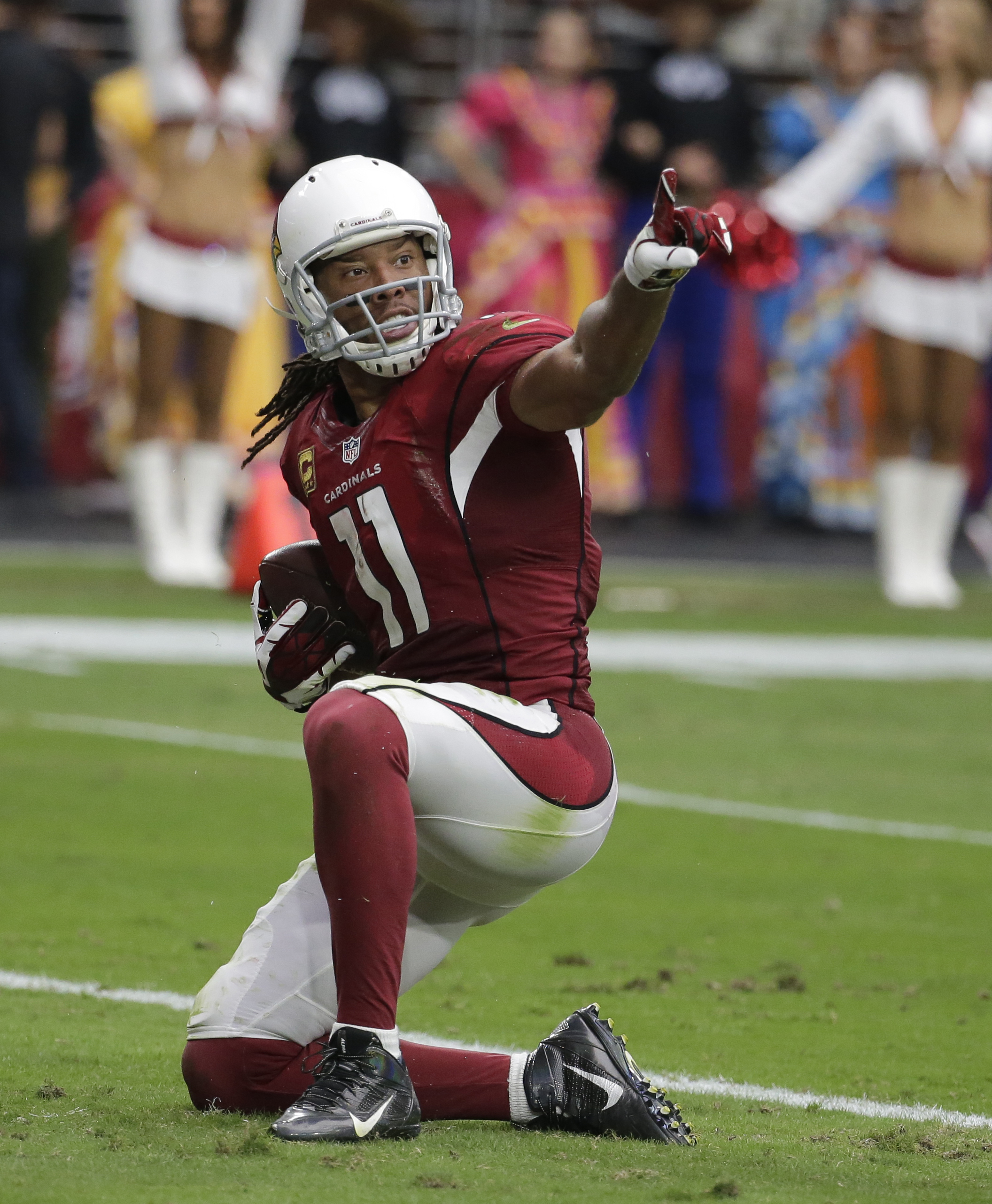 FILE - In this Sunday, Sept. 18, 2016, file photo, Arizona Cardinals wide receiver Larry Fitzgerald (11) during an NFL football game against the Tampa Bay Buccaneers in Glendale, Ariz. Star receiver Fitzgerald is mindful in remembering what happened in hi