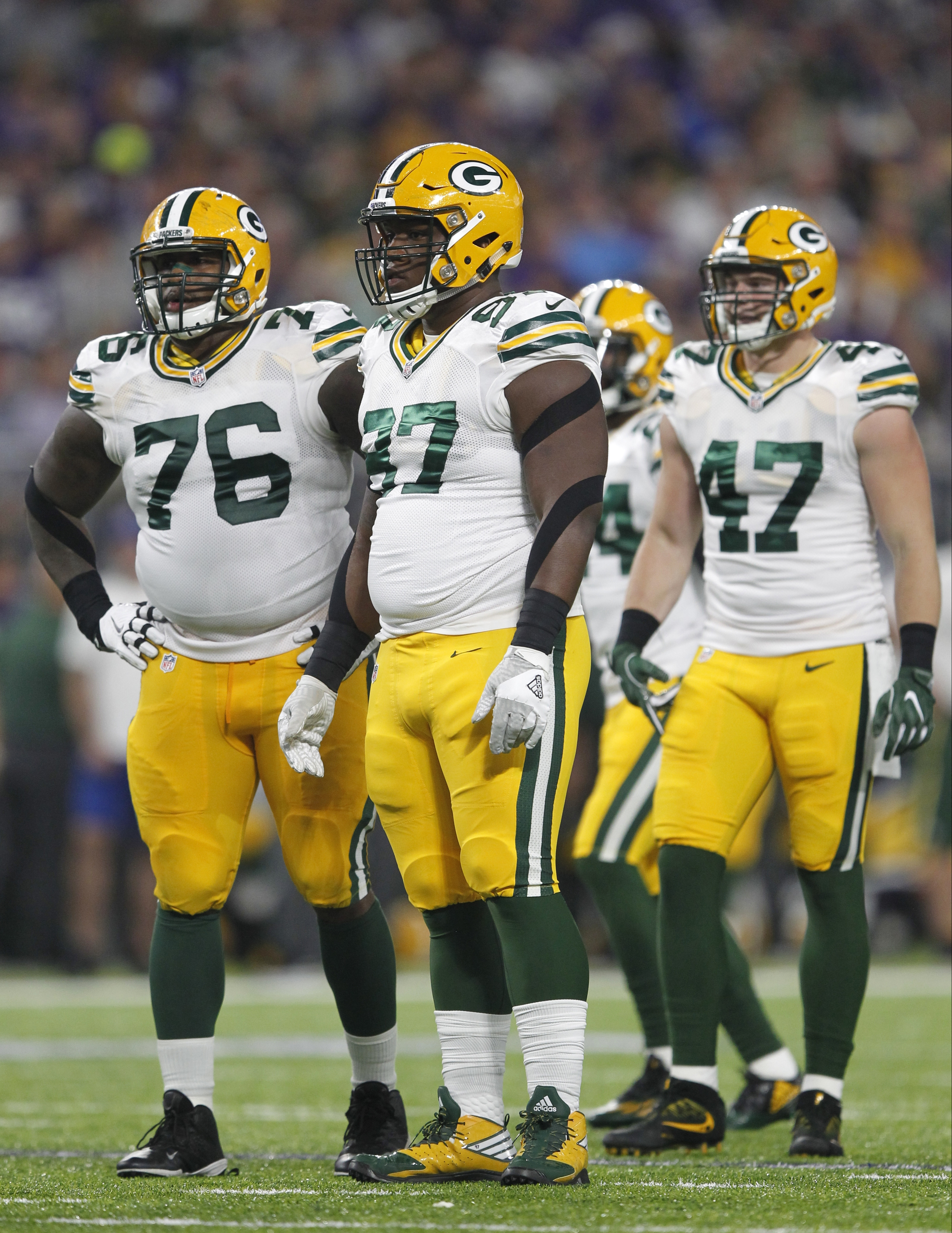 File-This Sept. 18, 2016, file photo shows Green Bay Packers defenders Mike Daniels (76), Kenny Clark (97) and Jake Ryan (47) getting set for a play during the first half of an NFL football game against the Minnesota Vikings in Minneapolis. he Packers hav