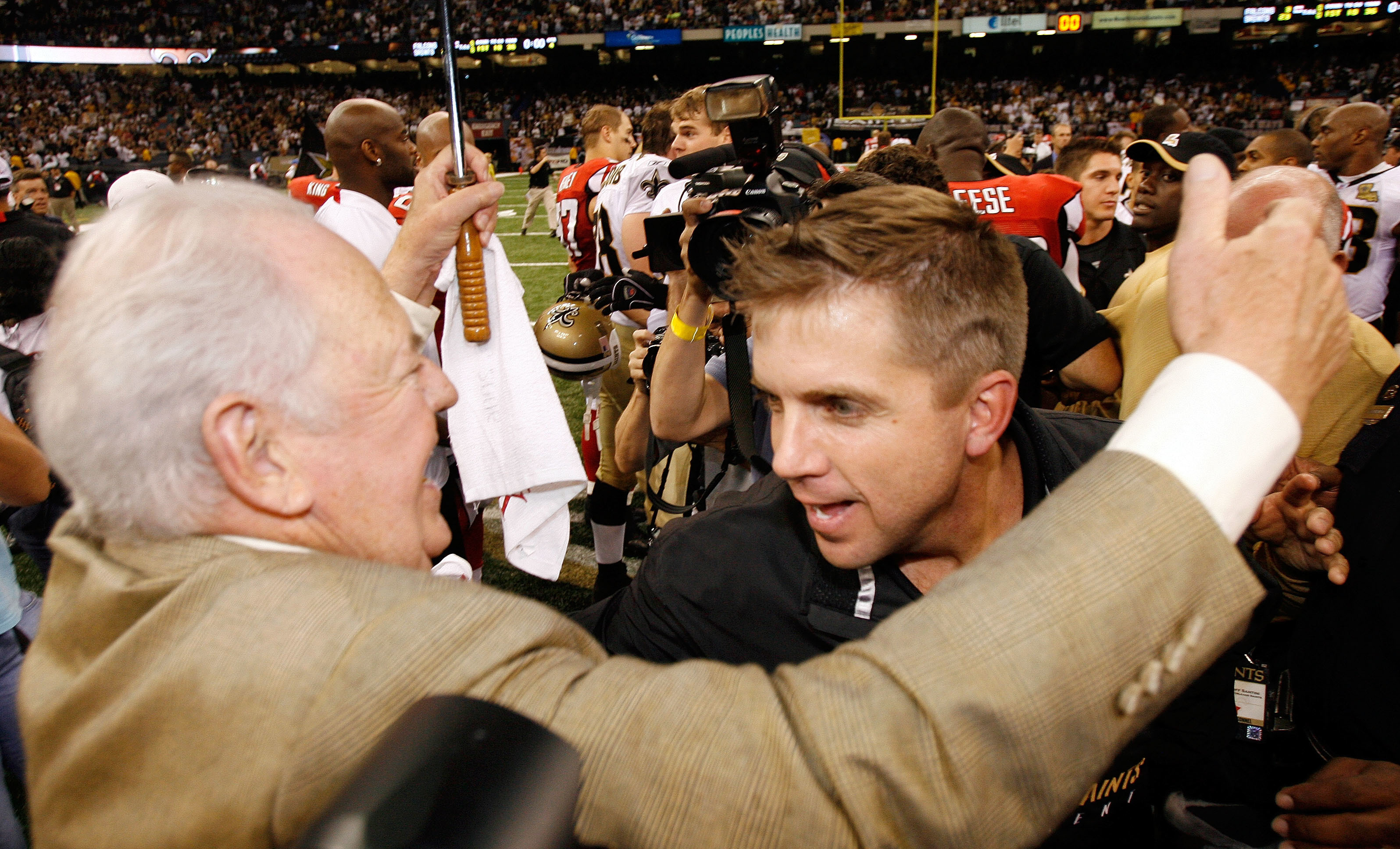File-This Sept. 25, 2006, file photo shows New Orleans Saints owner Tom Benson, left, hugging coach Sean Payton after their football game with Atlanta Falcons at the newly re-opened Louisiana Superdome in New Orleans.  Payton sees Monday nights matchup wi