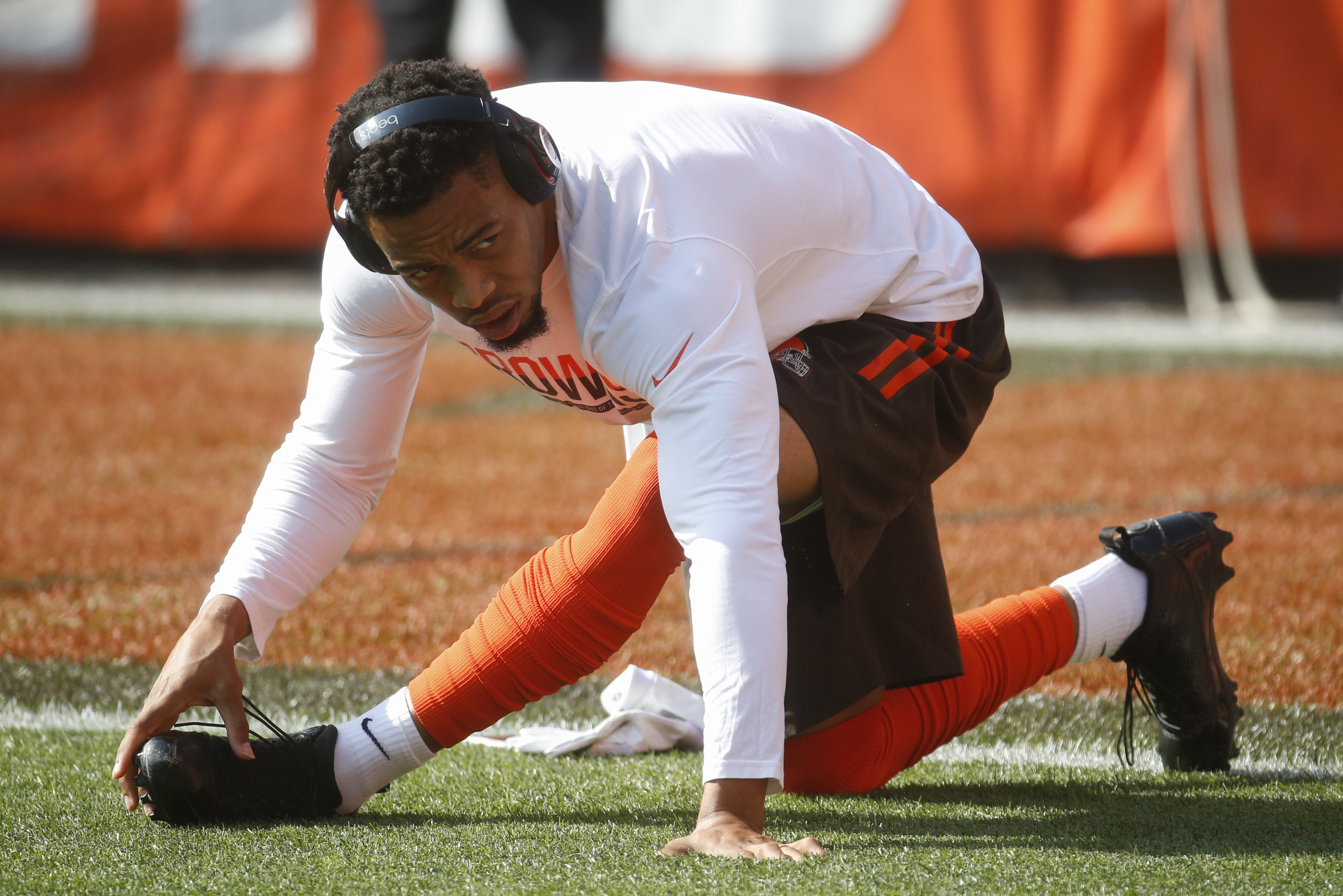 FILE- In this Sunday, Sept. 18, 2016, file photo, Cleveland Browns cornerback Joe Haden stretches before an NFL football game against the Baltimore Ravens in Cleveland. Haden, who has a strained groin, may miss Sundays game at Miami.(AP Photo/Ron Schwane,