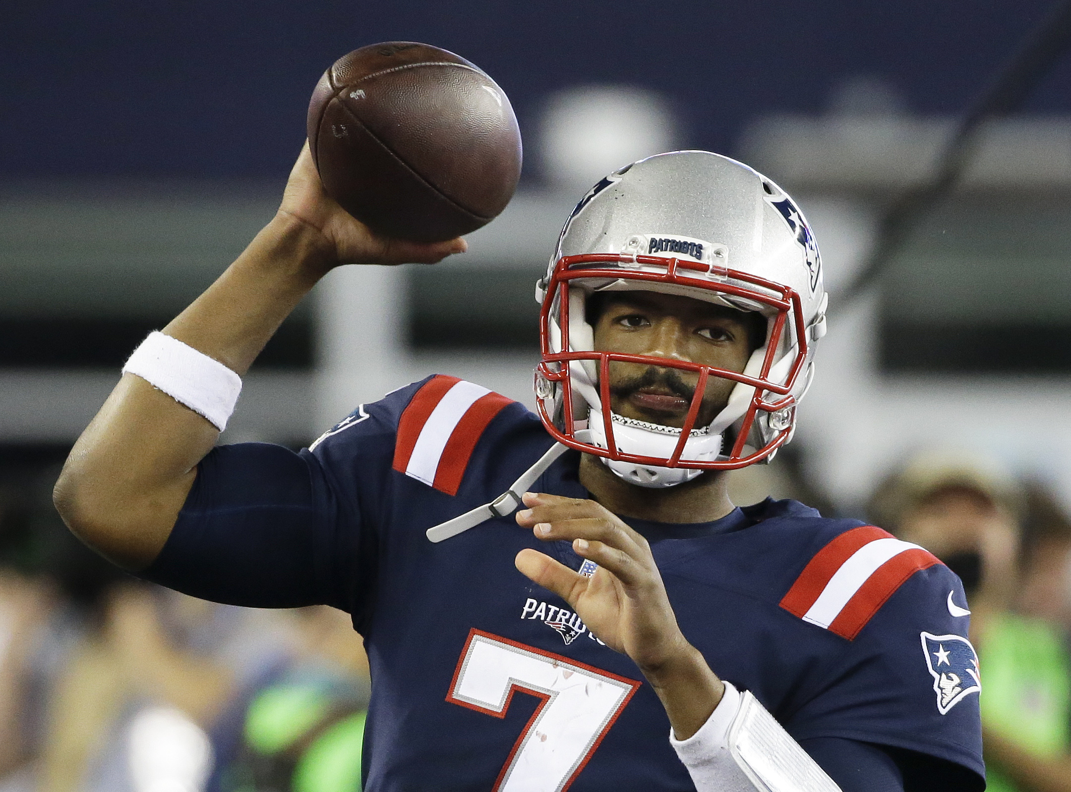 In this Thursday, Sept. 22, 2016 photo, New England Patriots quarterback Jacoby Brissett tosses the football on the sideline during the second half of an NFL football game against the Houston Texans in Foxborough, Mass. The patriots could be looking for y