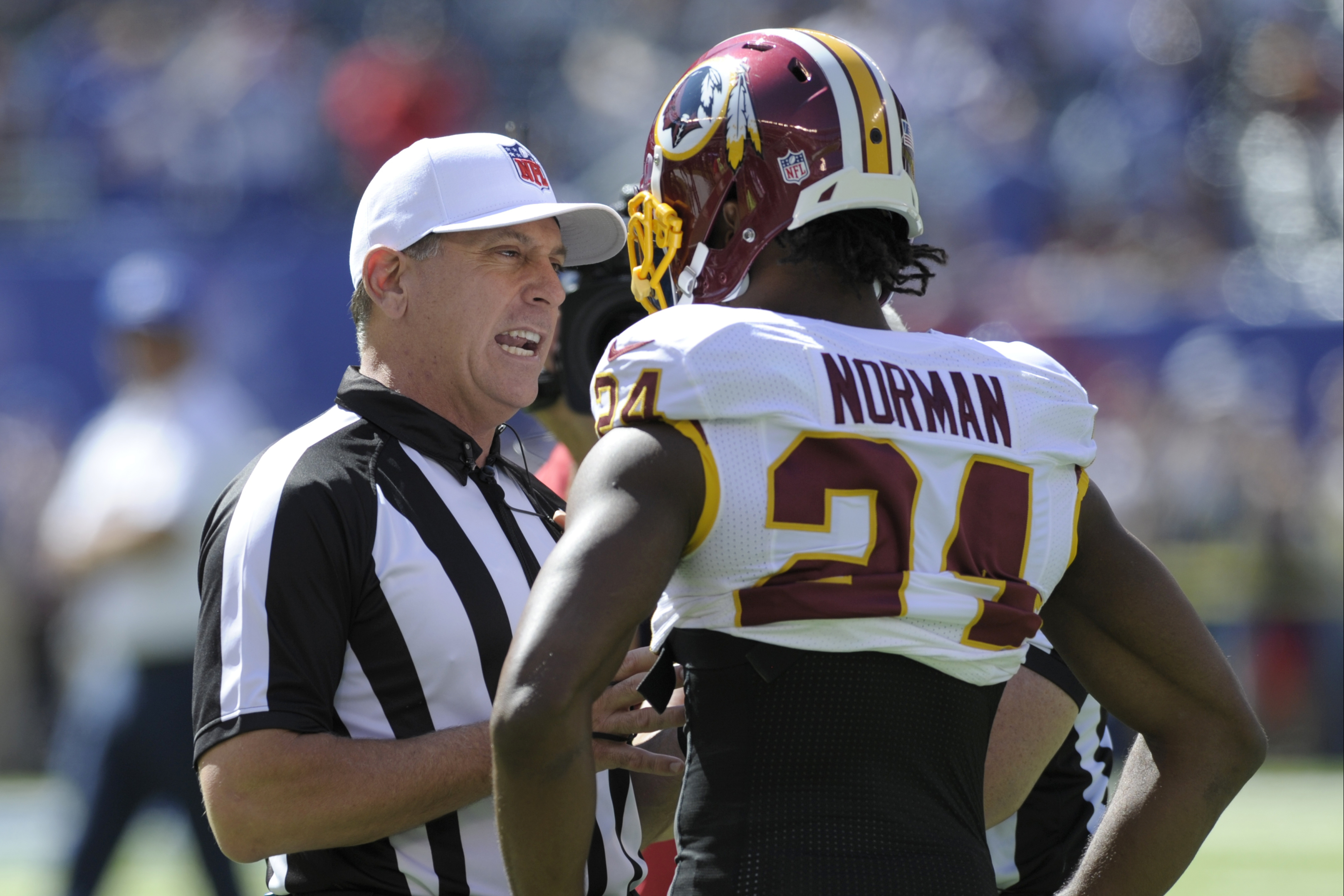 Washington Redskins cornerback Josh Norman (24) talks to officials before an NFL football game against the New York Giants Sunday, Sept. 25, 2016, in East Rutherford, N.J. (AP Photo/Bill Kostroun)
