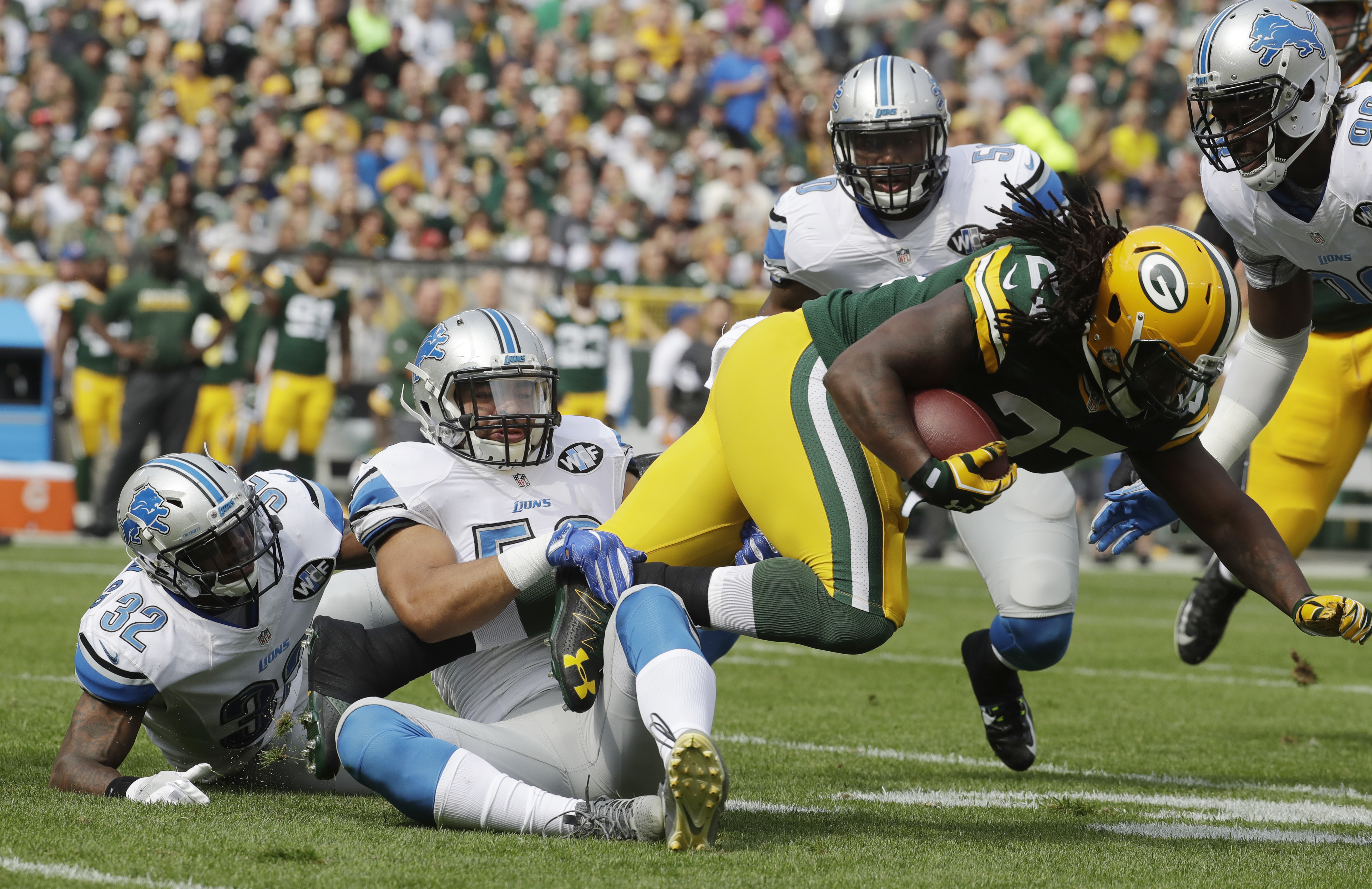 Detroit Lions' Kyle Van Noy tackles Green Bay Packers' Eddie Lacy during the first half of an NFL football game Sunday, Sept. 25, 2016, in Green Bay, Wis. (AP Photo/Morry Gash)