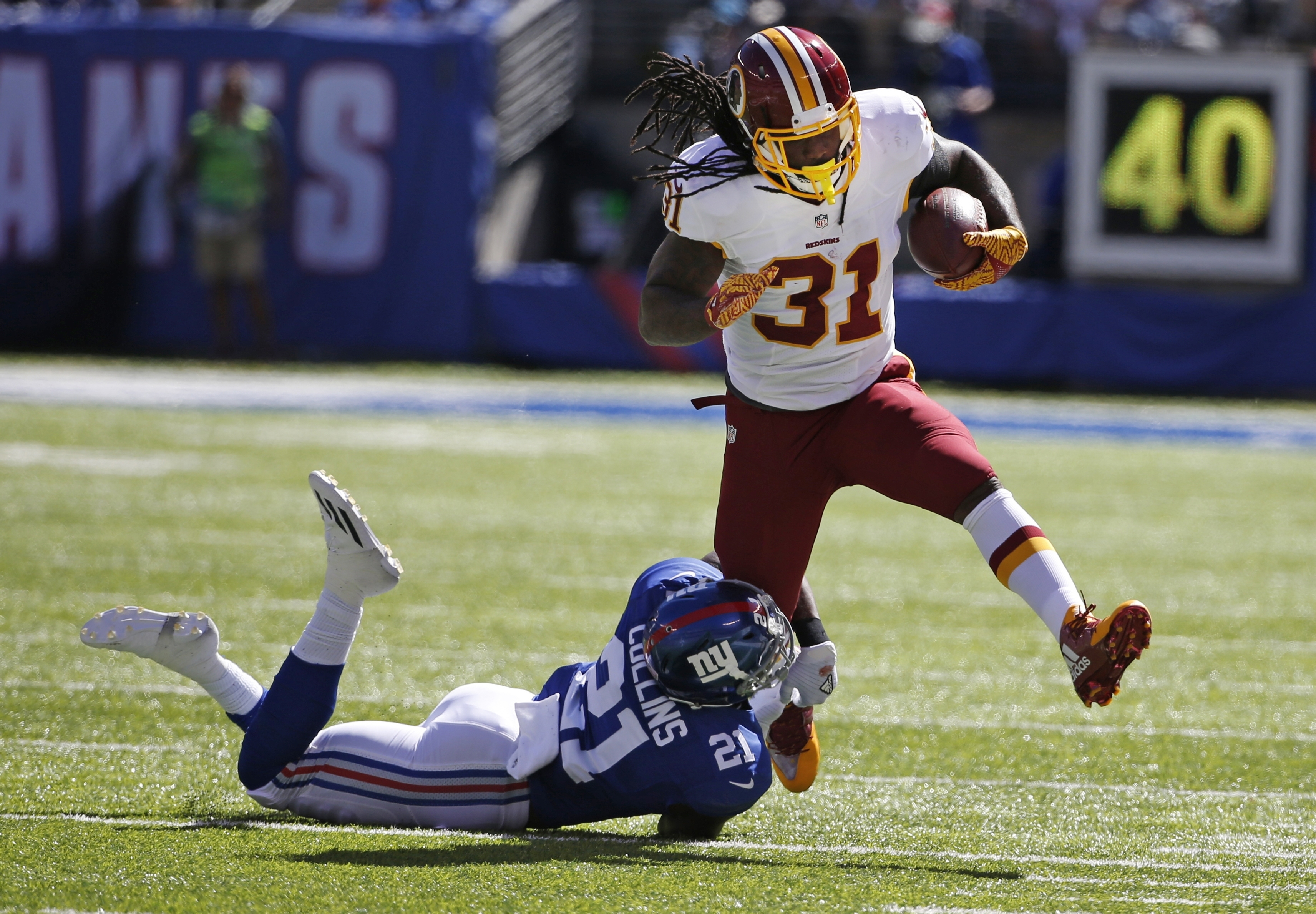 New York Giants' Landon Collins (21) tackles Washington Redskins' Matt Jones (31) during the first half of an NFL football game Sunday, Sept. 25, 2016, in East Rutherford, N.J. (AP Photo/Kathy Willens)