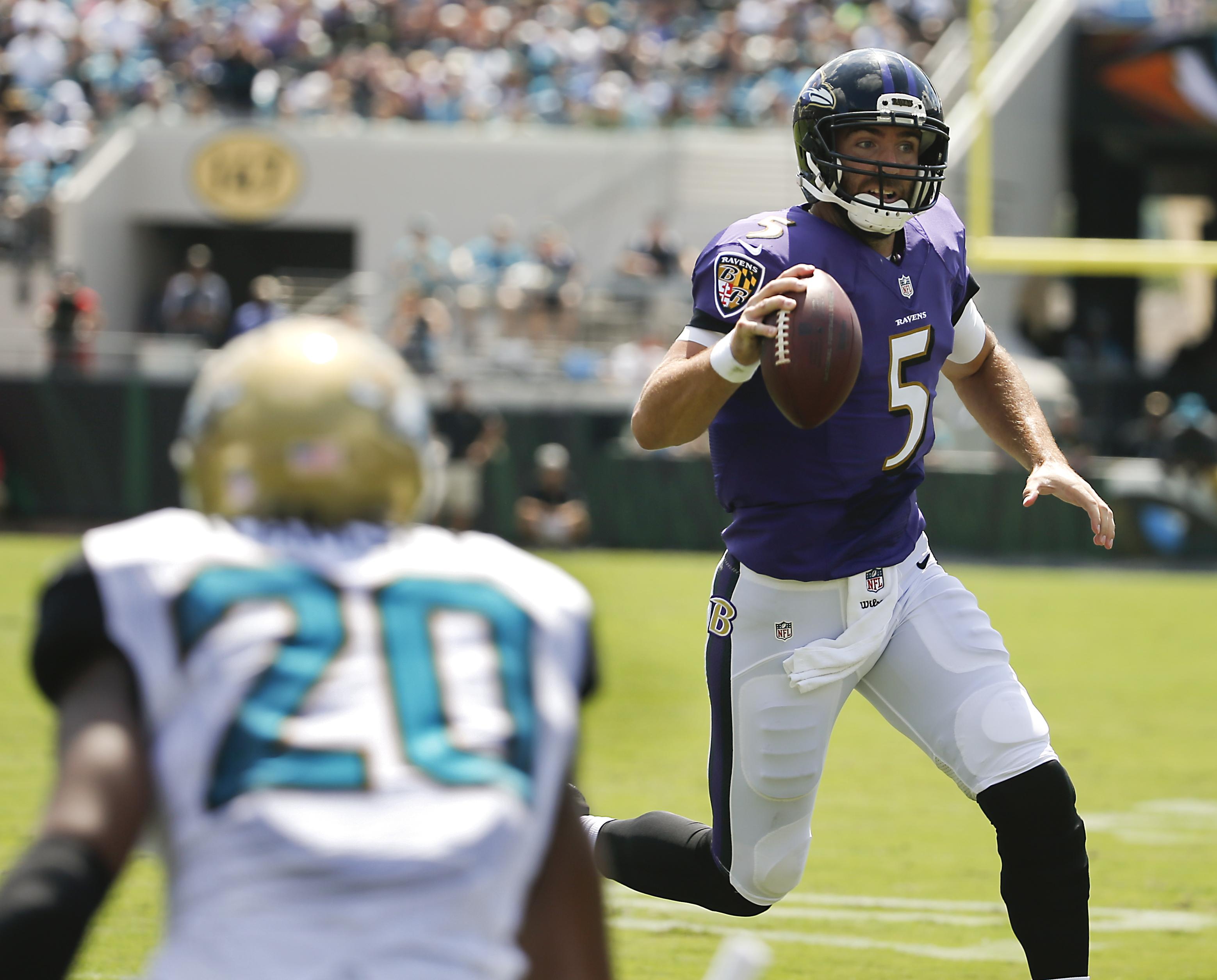 Baltimore Ravens quarterback Joe Flacco (5) rushes past Jacksonville Jaguars cornerback Jalen Ramsey (20) for a 7-yard touchdown run during the first half of an NFL football game in Jacksonville, Fla., Sunday, Sept. 25, 2016. (AP Photo/Stephen B. Morton)
