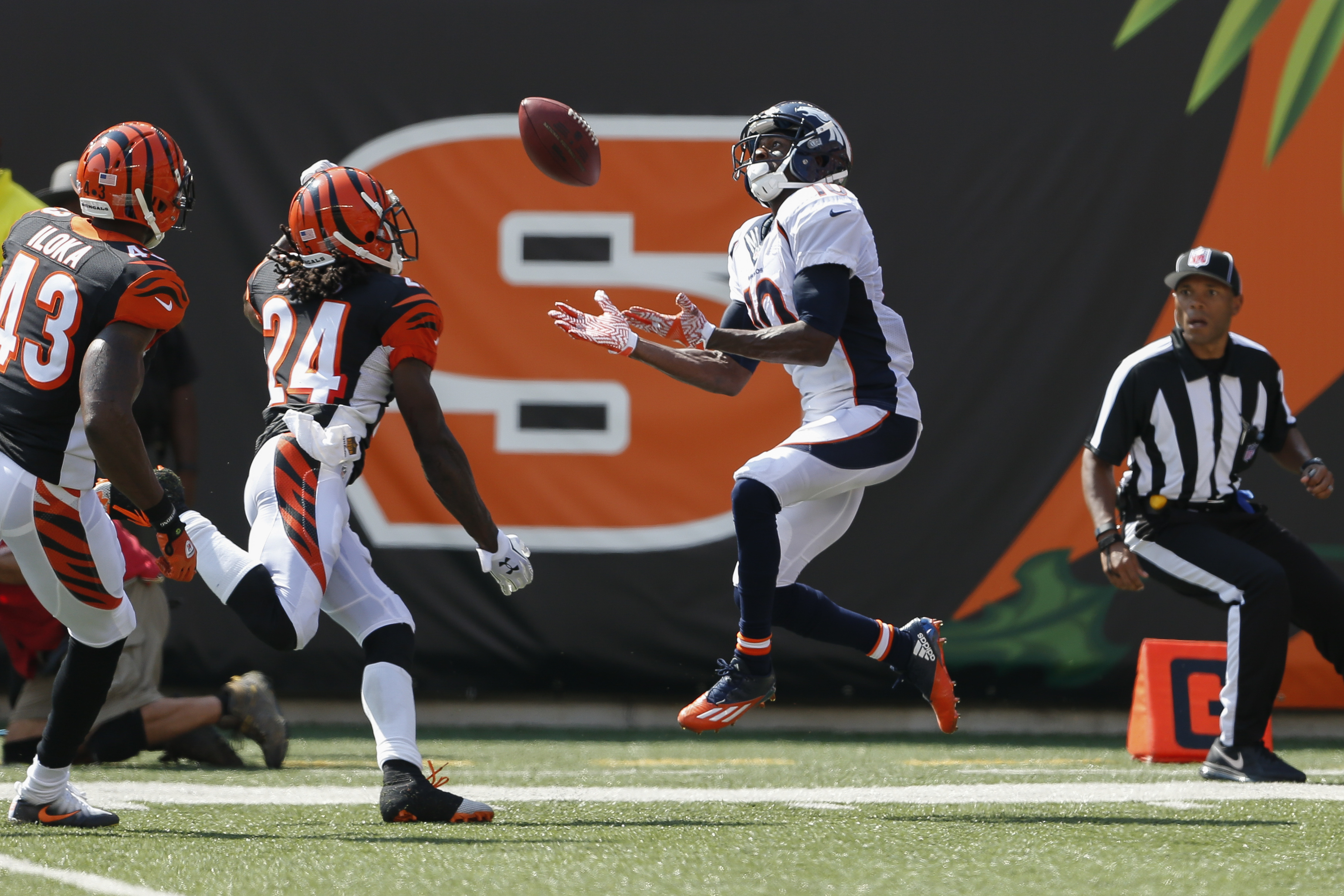 Denver Broncos wide receiver Emmanuel Sanders (10) catches a touchdown pass against Cincinnati Bengals cornerback Adam Jones (24) and free safety George Iloka (43) during the first half of an NFL football game, Sunday, Sept. 25, 2016, in Cincinnati. (AP P