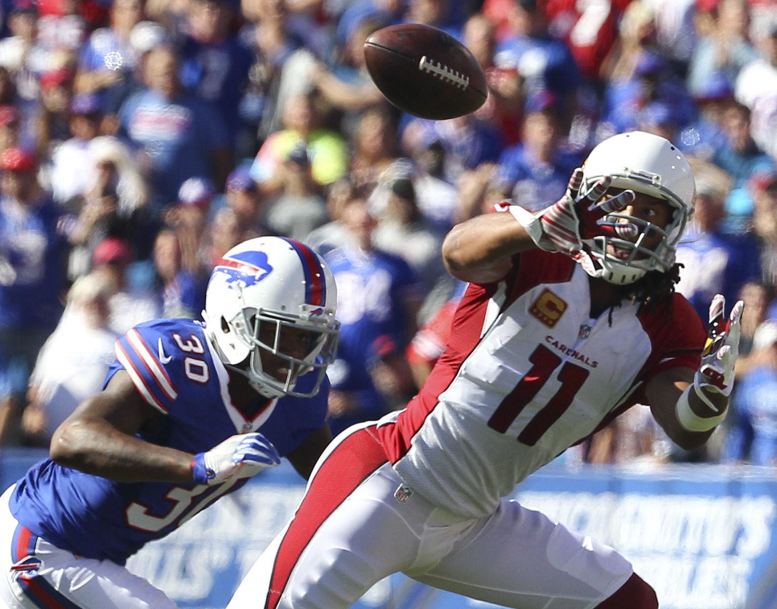 Arizona Cardinals wide receiver Larry Fitzgerald (11) makes a catch in front of Buffalo Bills defensive back Corey White (30) during the second half of an NFL football game on Sunday, Sept. 25, 2016, in Orchard Park, N.Y. (AP Photo/Bill Wippert)