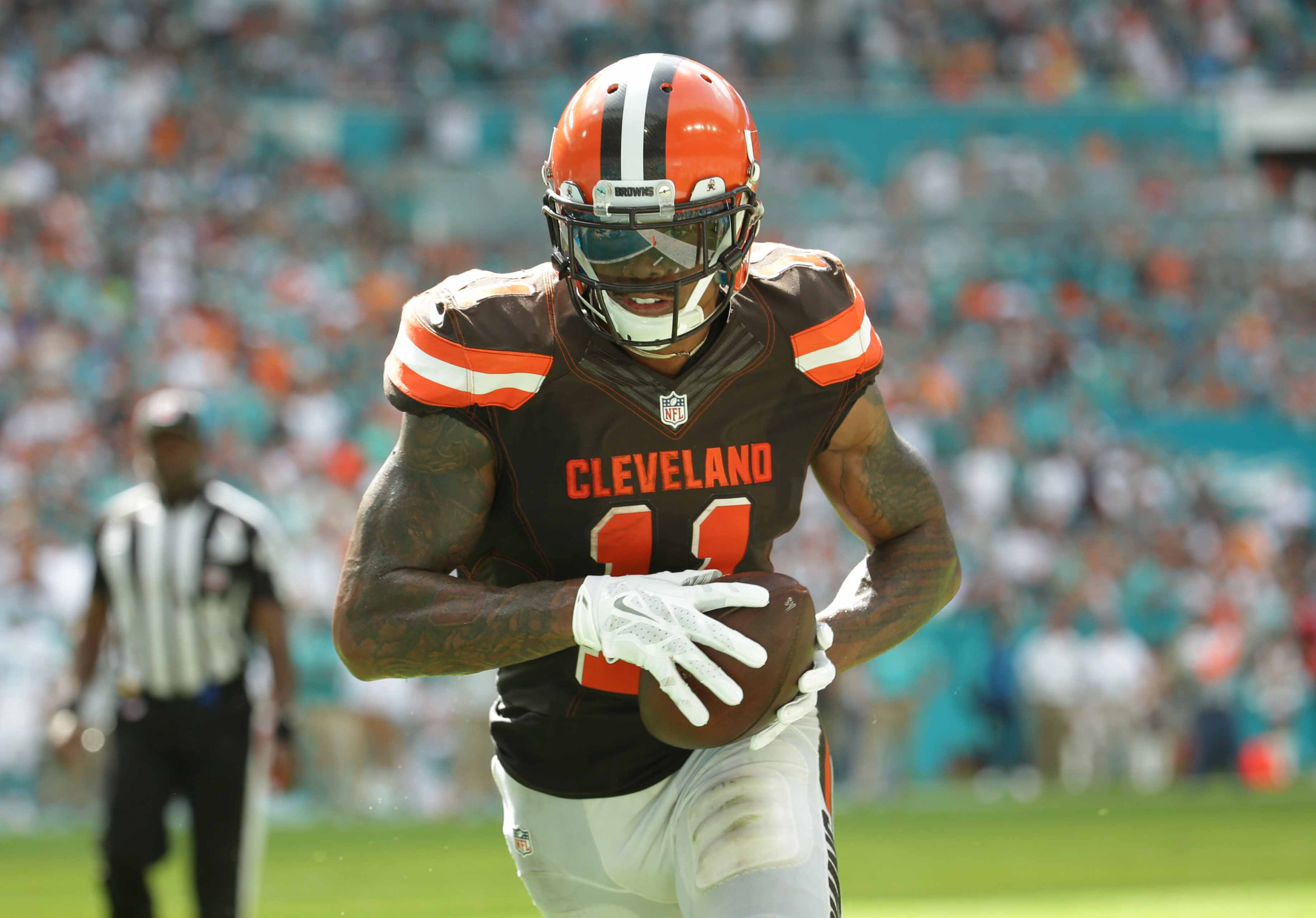 Cleveland Browns wide receiver Terrelle Pryor (11) runs for a touchdown during the second half of an NFL football game against the Miami Dolphins, Sunday, Sept. 25, 2016, in Miami Gardens, Fla. (AP Photo/Lynne Sladky)