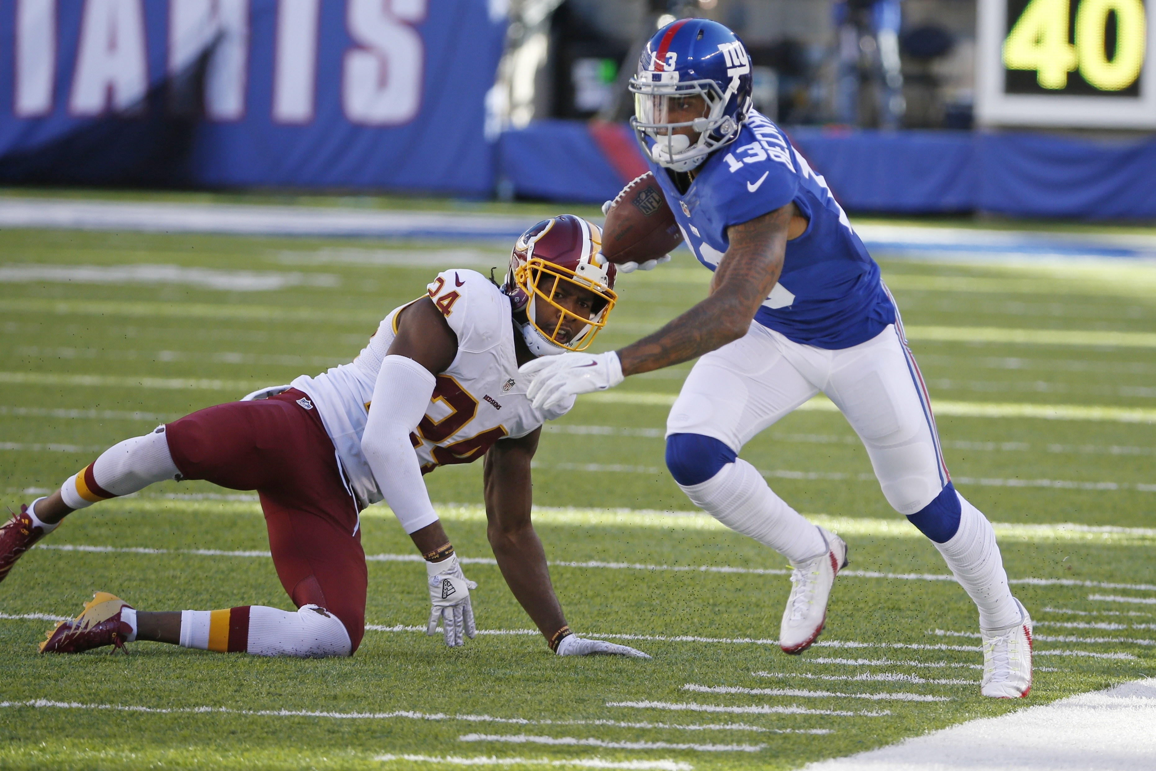 New York Giants wide receiver Odell Beckham Jr. (13) runs away from Washington Redskins' Josh Norman (24) during the second half of an NFL football game, Sunday, Sept. 25, 2016, in East Rutherford, N.J. (AP Photo/Kathy Willens)