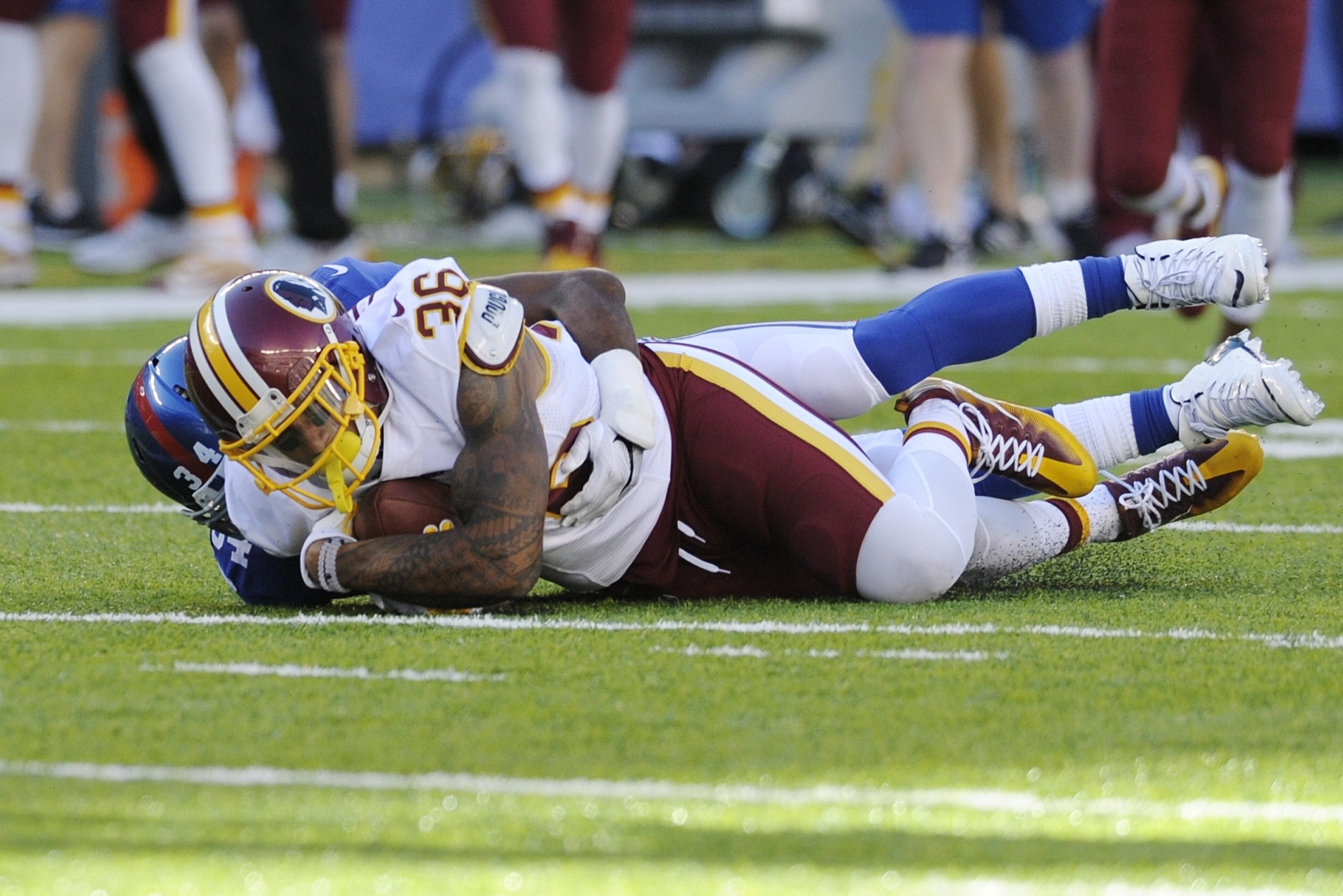 Washington Redskins defensive back Su'a Cravens (36) is tackled by New York Giants' Shane Vereen (34) after intercepting a pass during the second half of an NFL football game Sunday, Sept. 25, 2016, in East Rutherford, N.J. (AP Photo/Bill Kostroun)