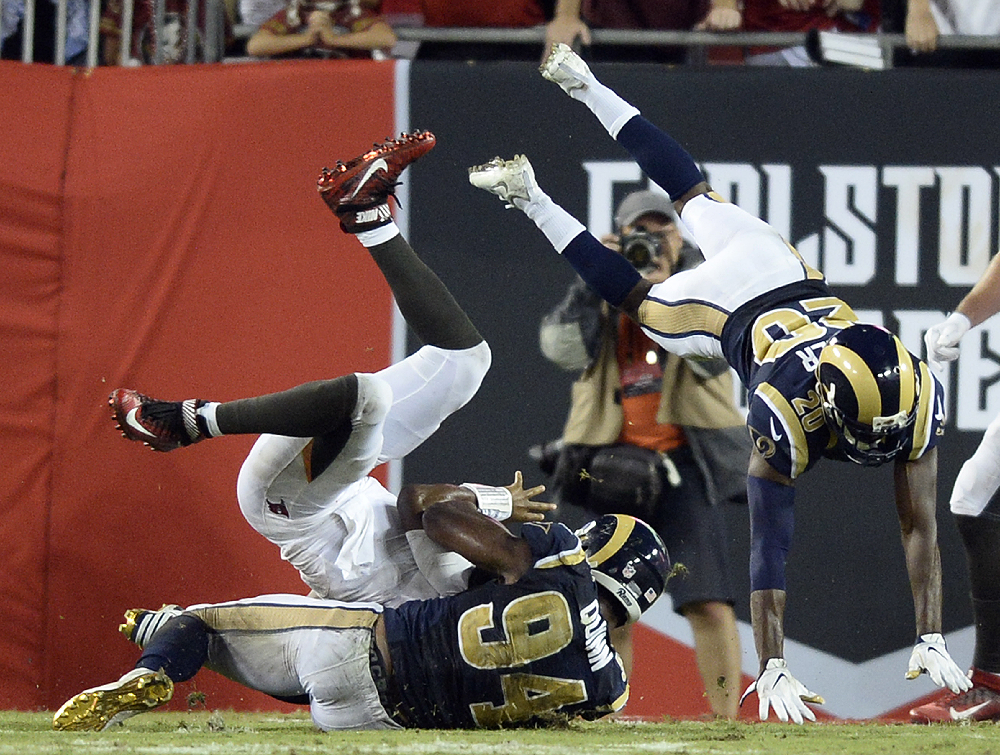 Los Angeles Rams cornerback Lamarcus Joyner (20) and defensive end Robert Quinn (94) stop Tampa Bay Buccaneers quarterback Jameis Winston from scoring during the final play of an NFL football game Sunday, Sept. 25, 2016, in Tampa, Fla. (AP Photo/Jason Beh