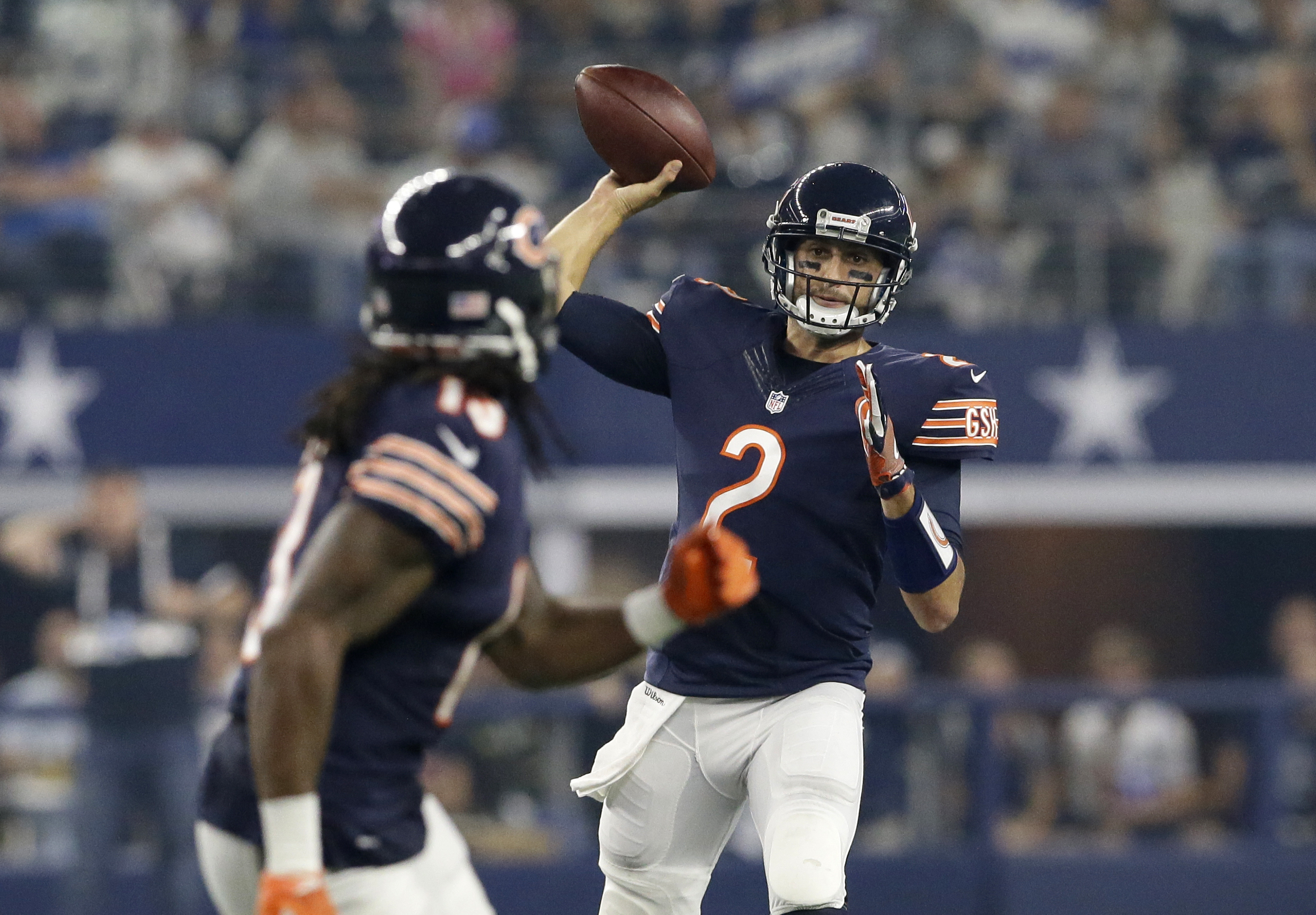 Chicago Bears quarterback Brian Hoyer (2) throws a completion to wide receiver Kevin White, front, in the second half of an NFL football game against the Dallas Cowboys on Sunday, Sept. 25, 2016, in Arlington, Texas. (AP Photo/LM Otero)