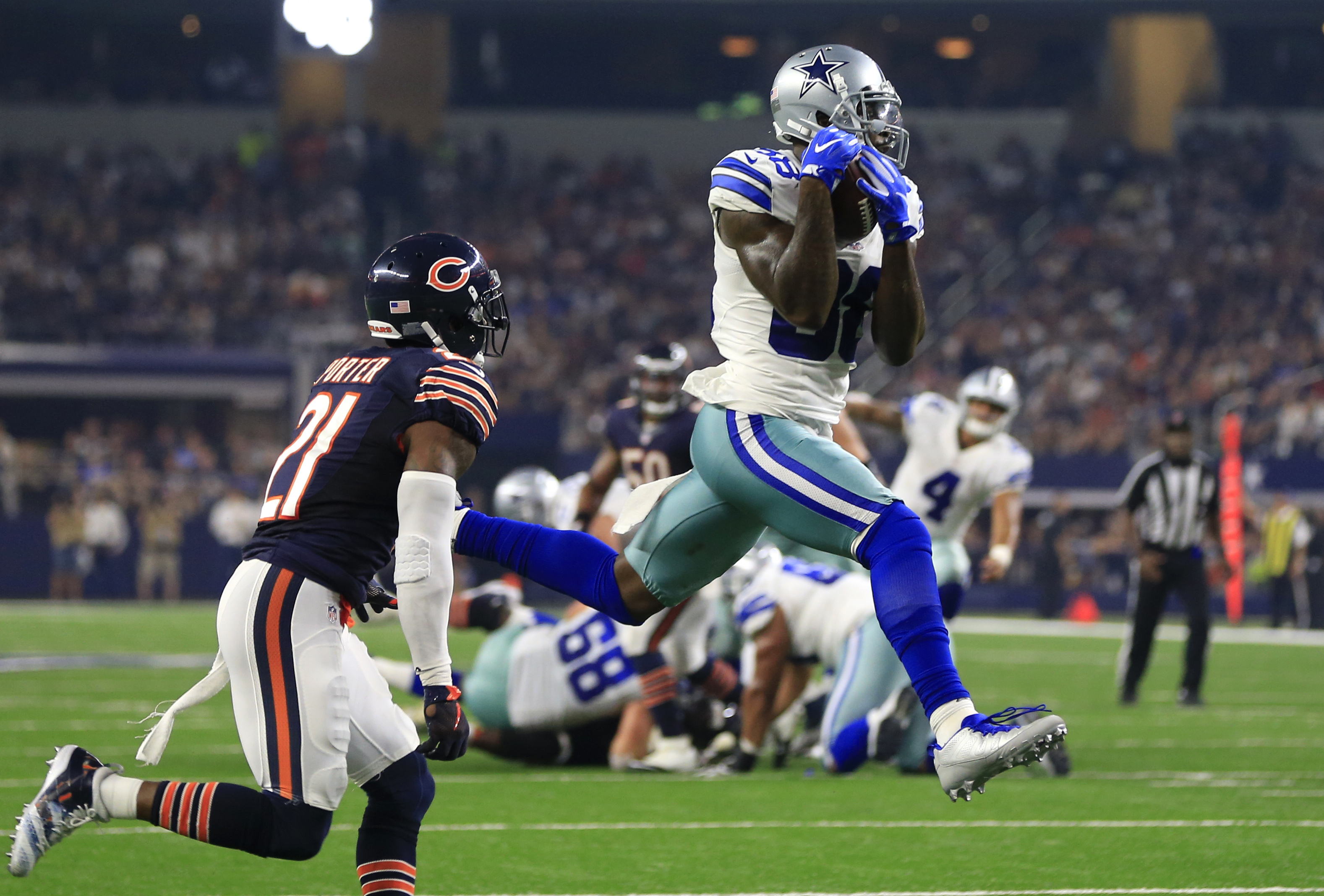 Chicago Bears cornerback Tracy Porter (21) defends as Dallas Cowboys wide receiver Dez Bryant (88) catches a pass thrown by Dak Prescott (4) for a touchdown in the second half of an NFL football game, Sunday, Sept. 25, 2016, in Arlington, Texas. (AP Photo