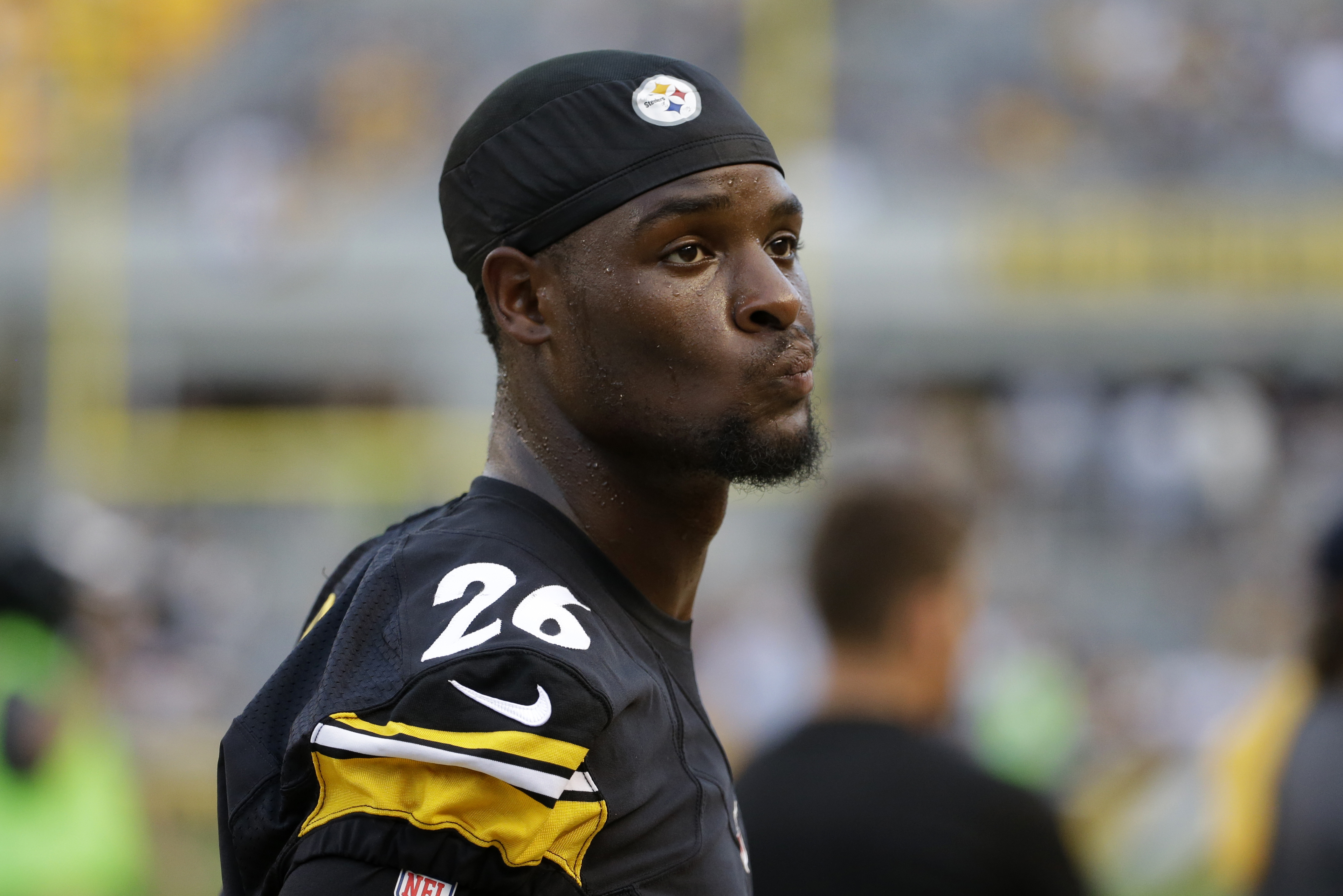FILE - In this Aug. 12, 2016, file photo, Pittsburgh Steelers running back Le'Veon Bell stands on the sideline during the first half of an NFL exhibition football game against the Detroit Lions in Pittsburgh. Bell is eager to get back to work and put behi