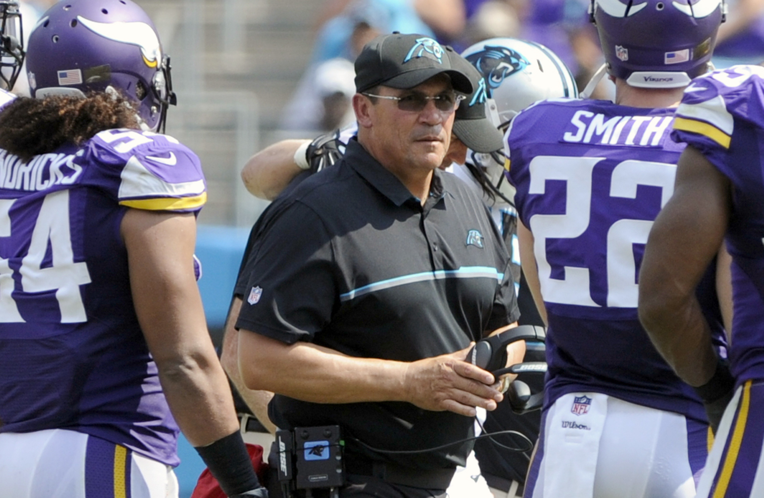 FILE - In this Sept. 25, 2016, file photo, Carolina Panthers head coach Ron Rivera, center, walks through Minnesota Vikings players in the first half of an NFL football game in Charlotte, N.C. Rivera said Monday that two things became apparent to him afte