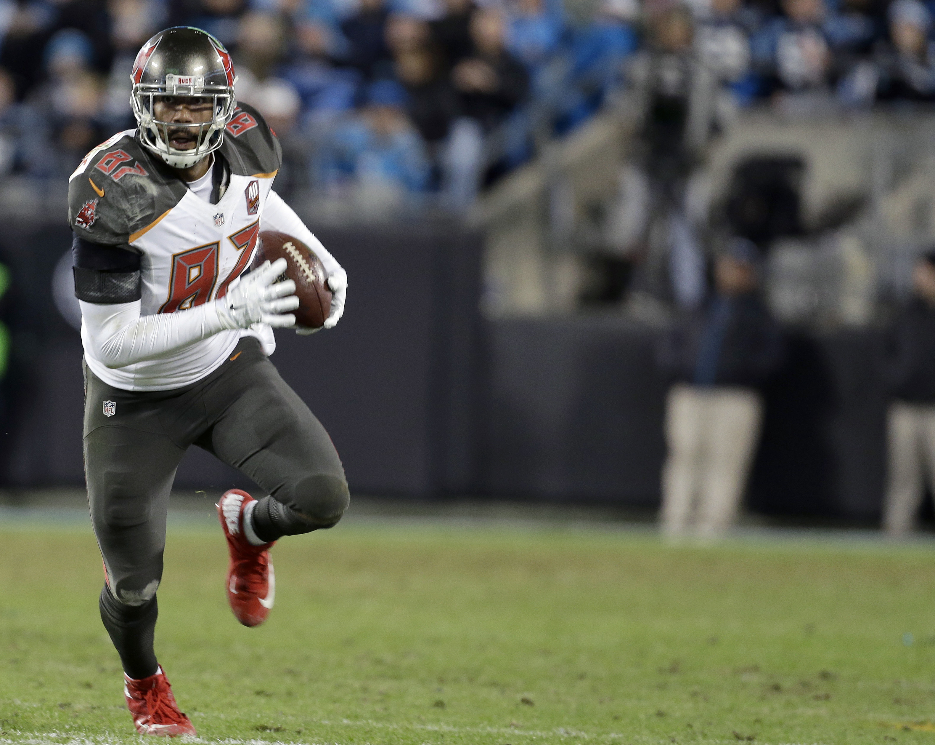 FILE - In this Jan, 3, 2016, file photo, Tampa Bay Buccaneers' Austin Seferian-Jenkins (87) runs all alone against the Carolina Panthers during the second half of an NFL football game in Charlotte, N.C. The New York Jets have claimed tight end  Seferian-J