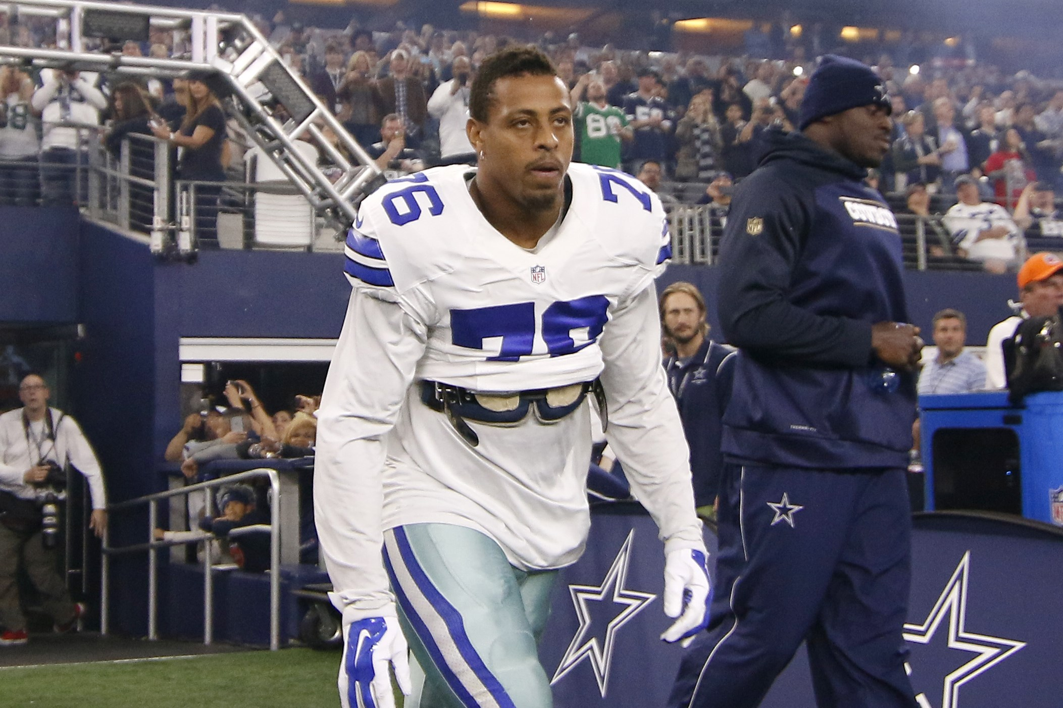 Dallas Cowboys defensive end Greg Hardy jots out onto the field with the team for an NFL football game against the New York Jets on Saturday, Dec. 19, 2015, in Arlington, Texas. (AP Photo/Roger Steinman)