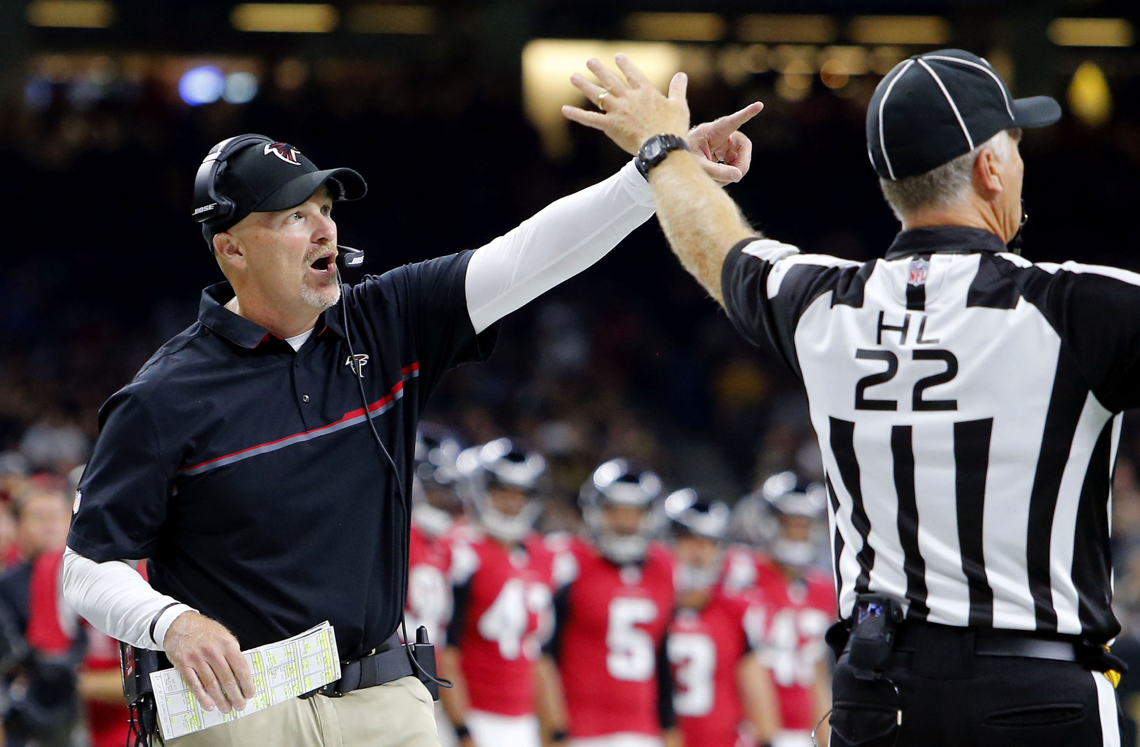 Atlanta Falcons head coach Dan Quinn challenges an official in the first half of an NFL football game against the New Orleans Saints in New Orleans, Monday, Sept. 26, 2016. (AP Photo/Butch Dill)
