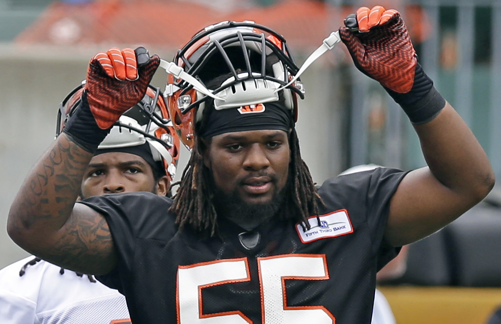FILE - In this June 10, 2014, file photo, Cincinnati Bengals outside linebacker Vontaze Burfict adjusts his helmet during an NFL football mandatory minicamp in Cincinnati. The Bengals think that they'll improve significantly with Burfict back at linebacke