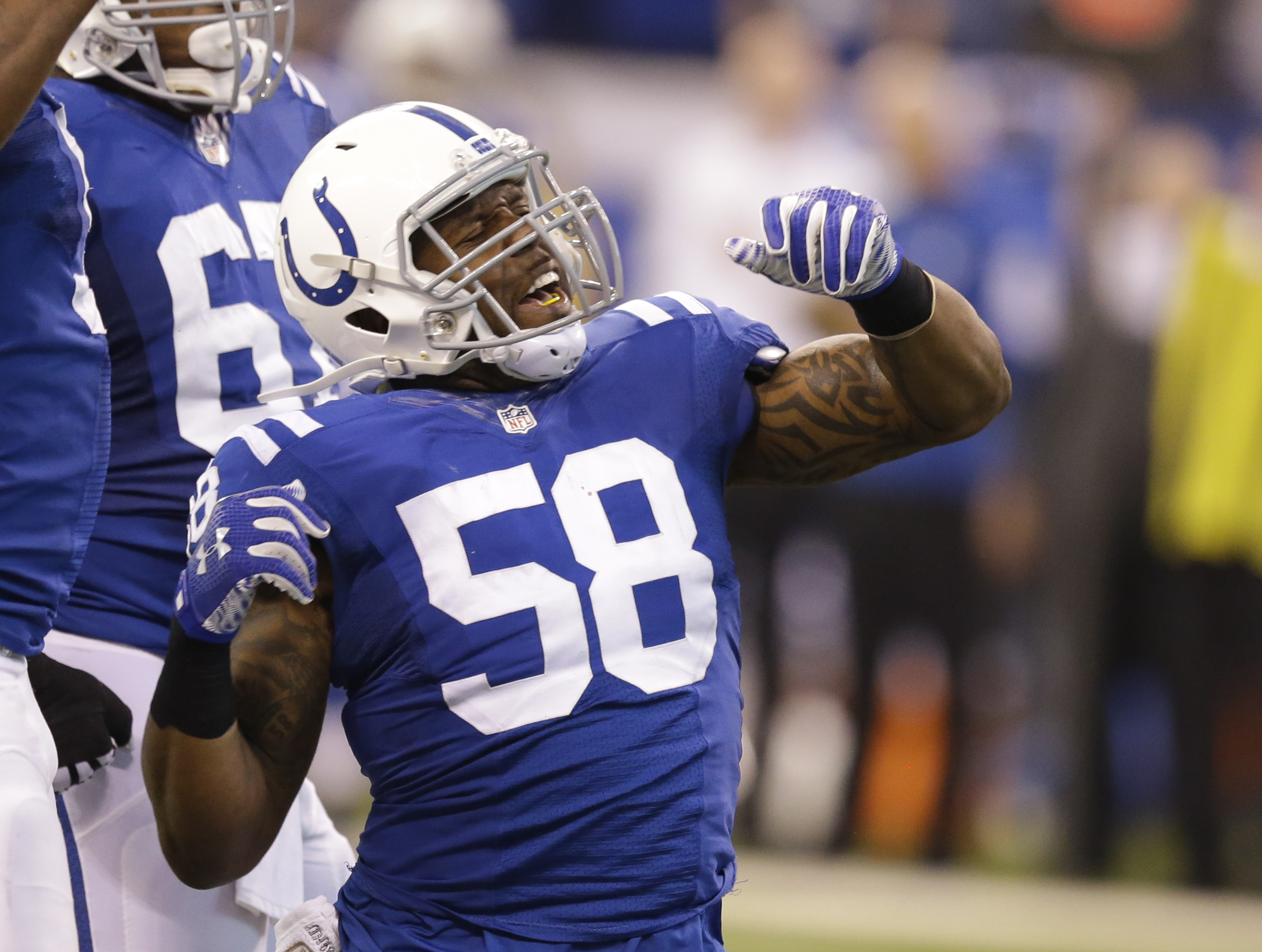 FILE - In this Dec. 20, 2015, file photo, Indianapolis Colts' Trent Cole (58) celebrates after a sack of Houston Texans quarterback T.J. Yates during the first half of an NFL football game in Indianapolis.  The Colts put Cole on injured reserve Tuesday, S