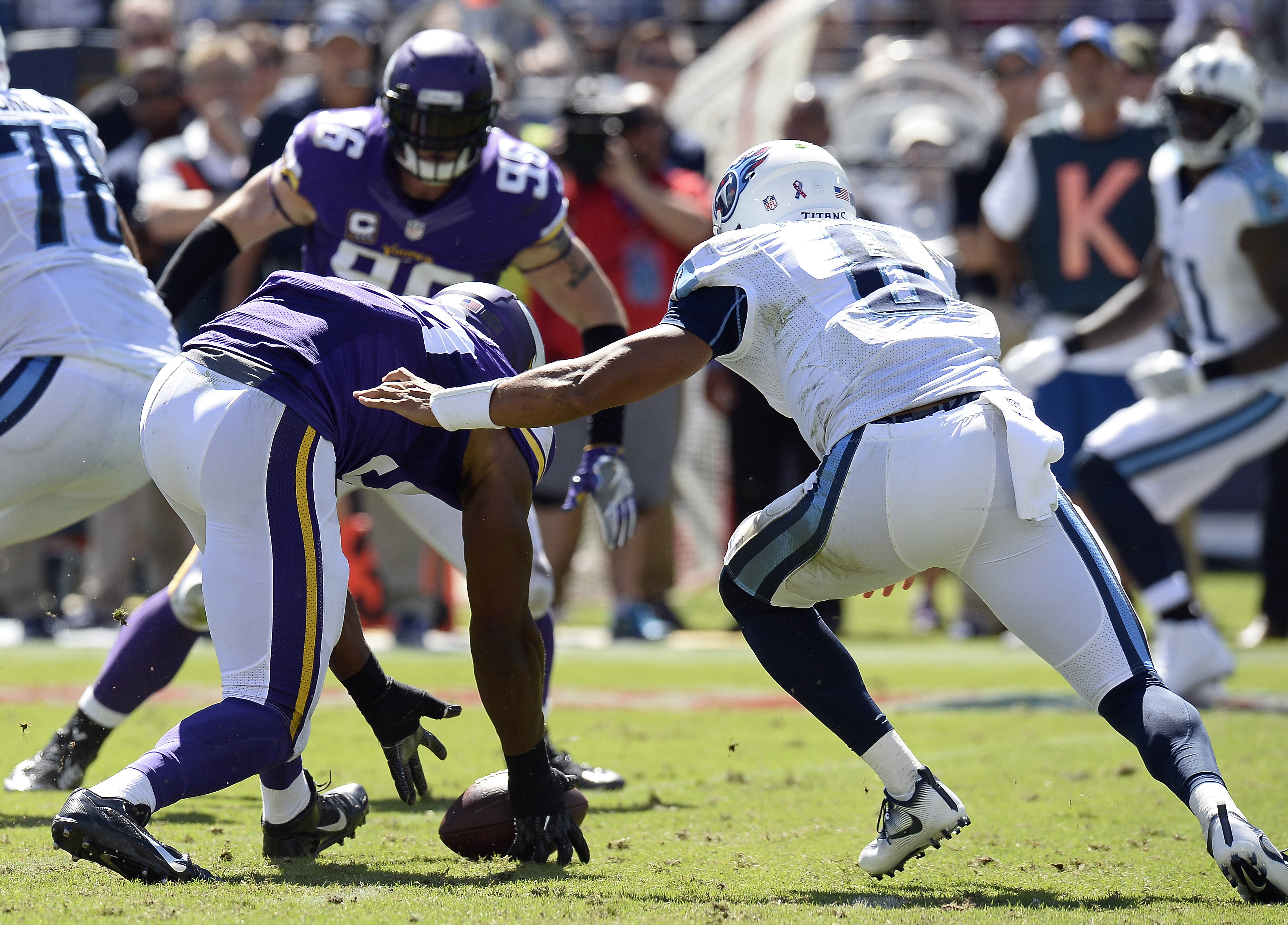 FILE - In this Sunday, Sept. 11, 2016, file photo, Minnesota Vikings defensive end Danielle Hunter, left, recovers a fumble by Tennessee Titans quarterback Marcus Mariota, right, and returns it 24 yards for a touchdown in the second half of an NFL footbal