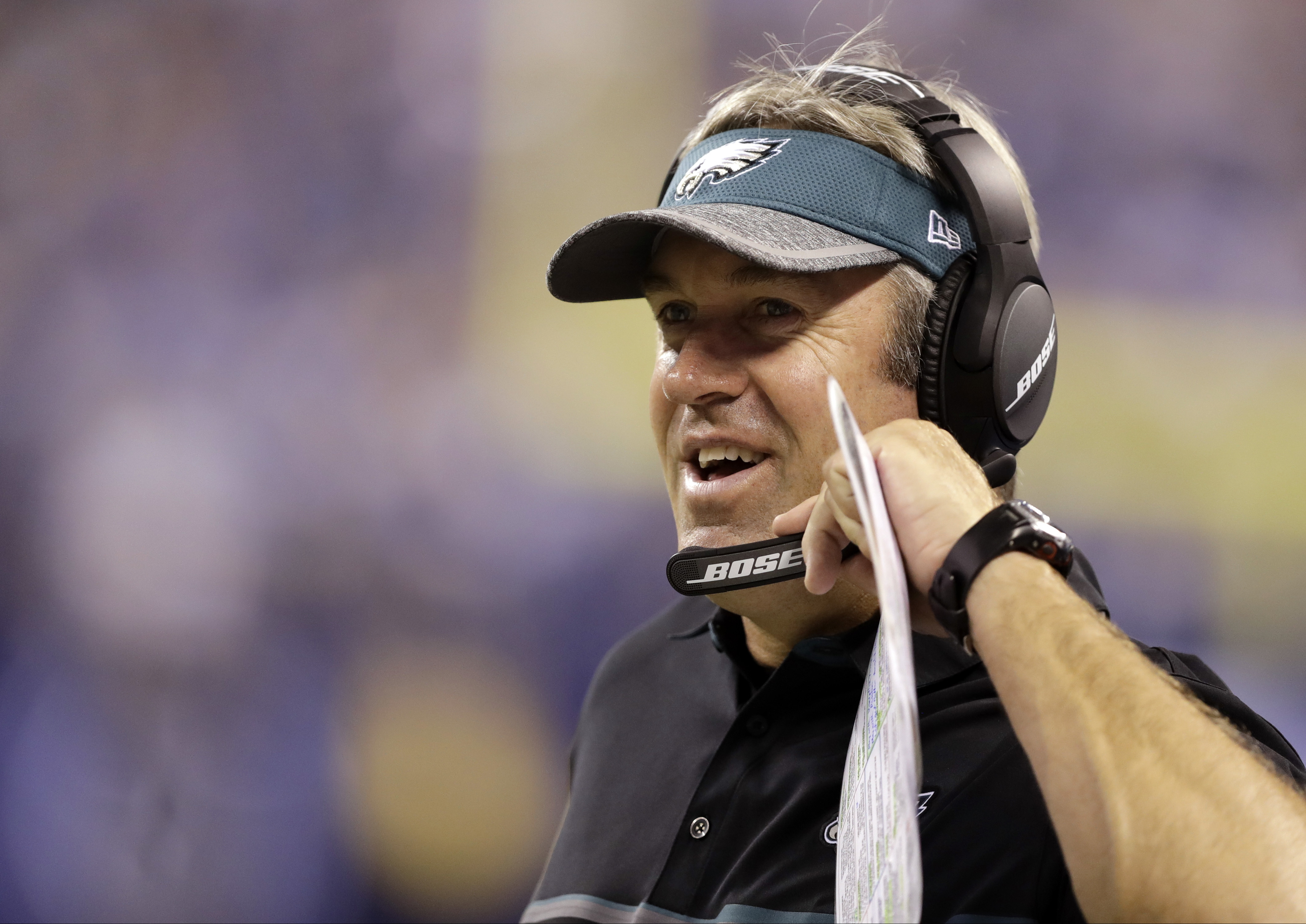 FILE - In this Aug. 27, 2016, file photo, Philadelphia Eagles head coach Doug Pederson smiles on the sideline during the first half of an NFL preseason football game against the Indianapolis Colts in Indianapolis. Carson Wentz and the unbeaten Eagles were
