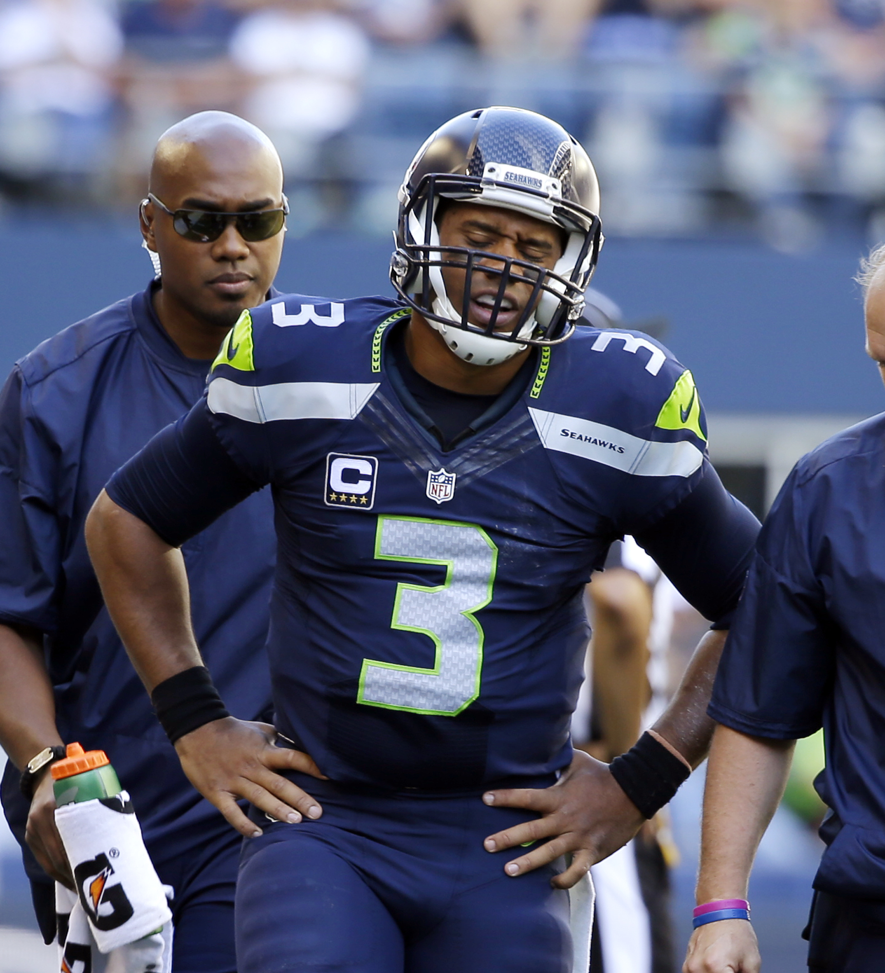 FILE - In this Sunday, Sept. 25, 2016, file photo,Seattle Seahawks quarterback Russell Wilson walks off the field after being brought down against the San Francisco 49ers in the second half of an NFL football game Seattle. Despite spraining the medial col