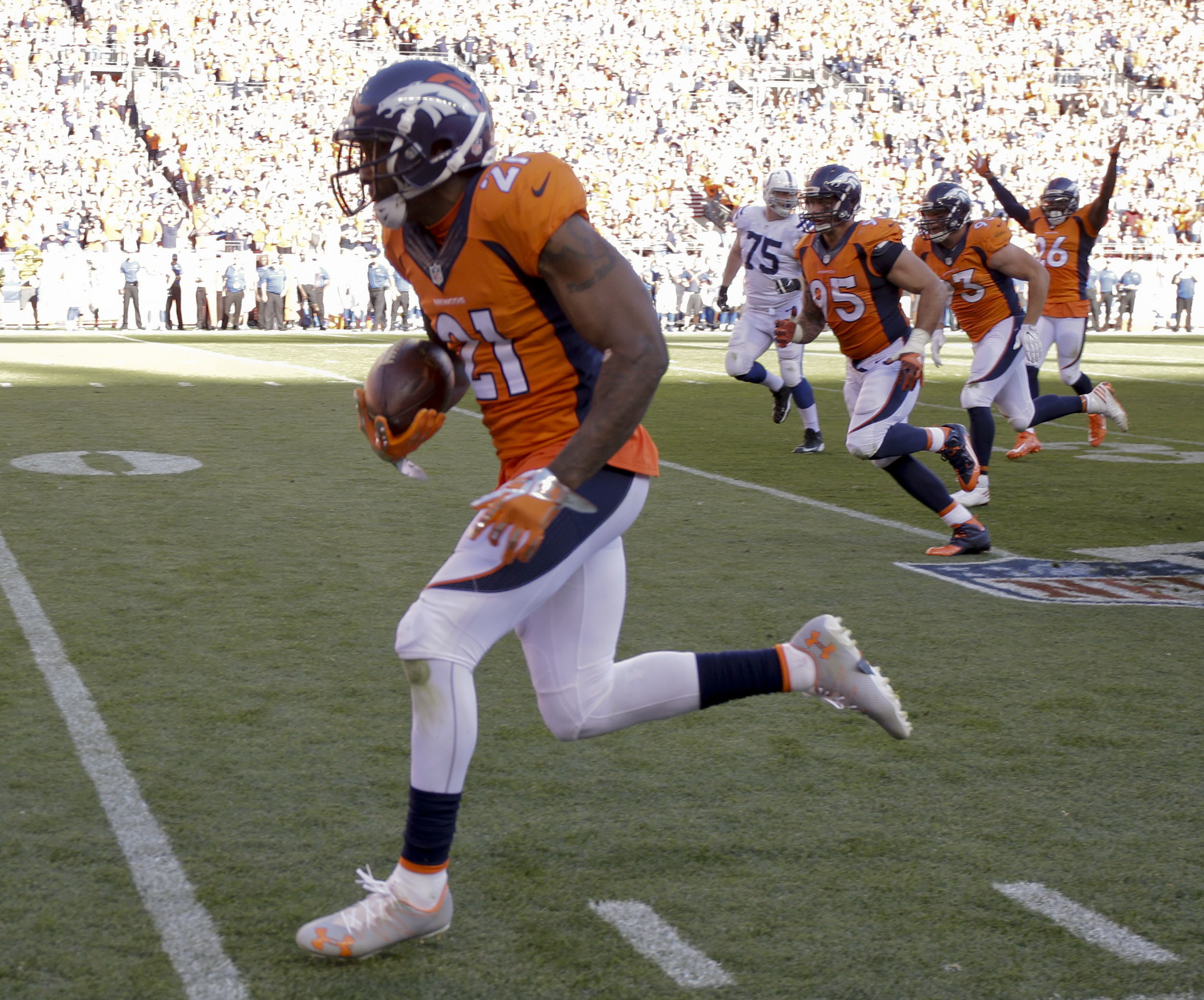 FILE - In this Sept. 18, 2016, file photo, Denver Broncos cornerback Aqib Talib scores after a interception during the second half in a NFL football game against the Indianapolis Colts in Denver. Talib returns to Tampa for the first time with 31 intercept