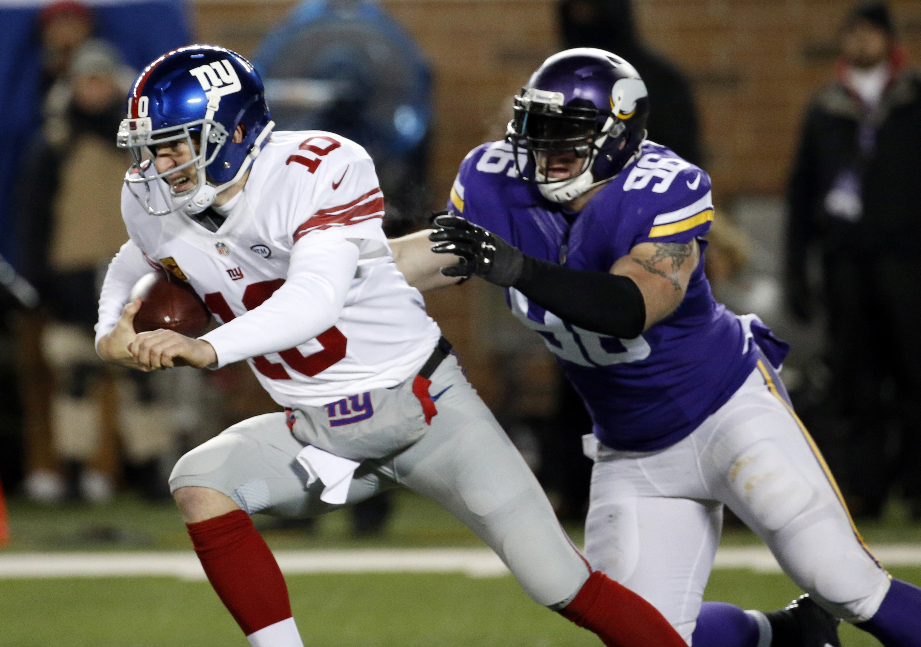 FILE - In this Dec. 22, 2015, file photo, New York Giants quarterback Eli Manning (10) tries to get away from Minnesota Vikings defensive end Brian Robison during the first half of an NFL football game in Minneapolis. In seven career starts against the Vi