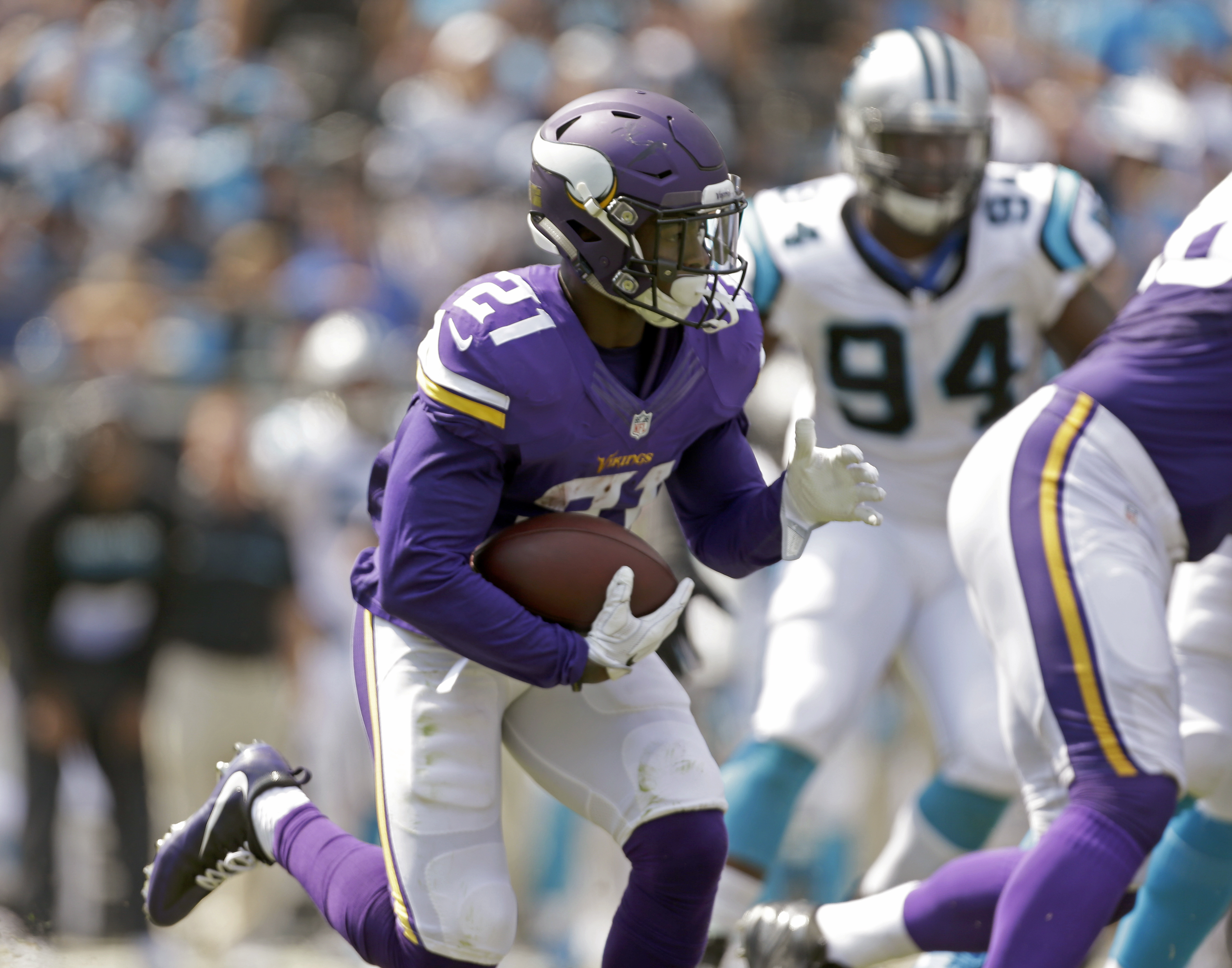 FILE - In this Sept. 18, 2016, file photo, Minnesota Vikings' Jerick McKinnon (21) looks to turn the corner against the Carolina Panthers during an NFL football game in Charlotte, N.C. The Vikings, whove turned to McKinnon and Matt Asiata with Adrian Pete