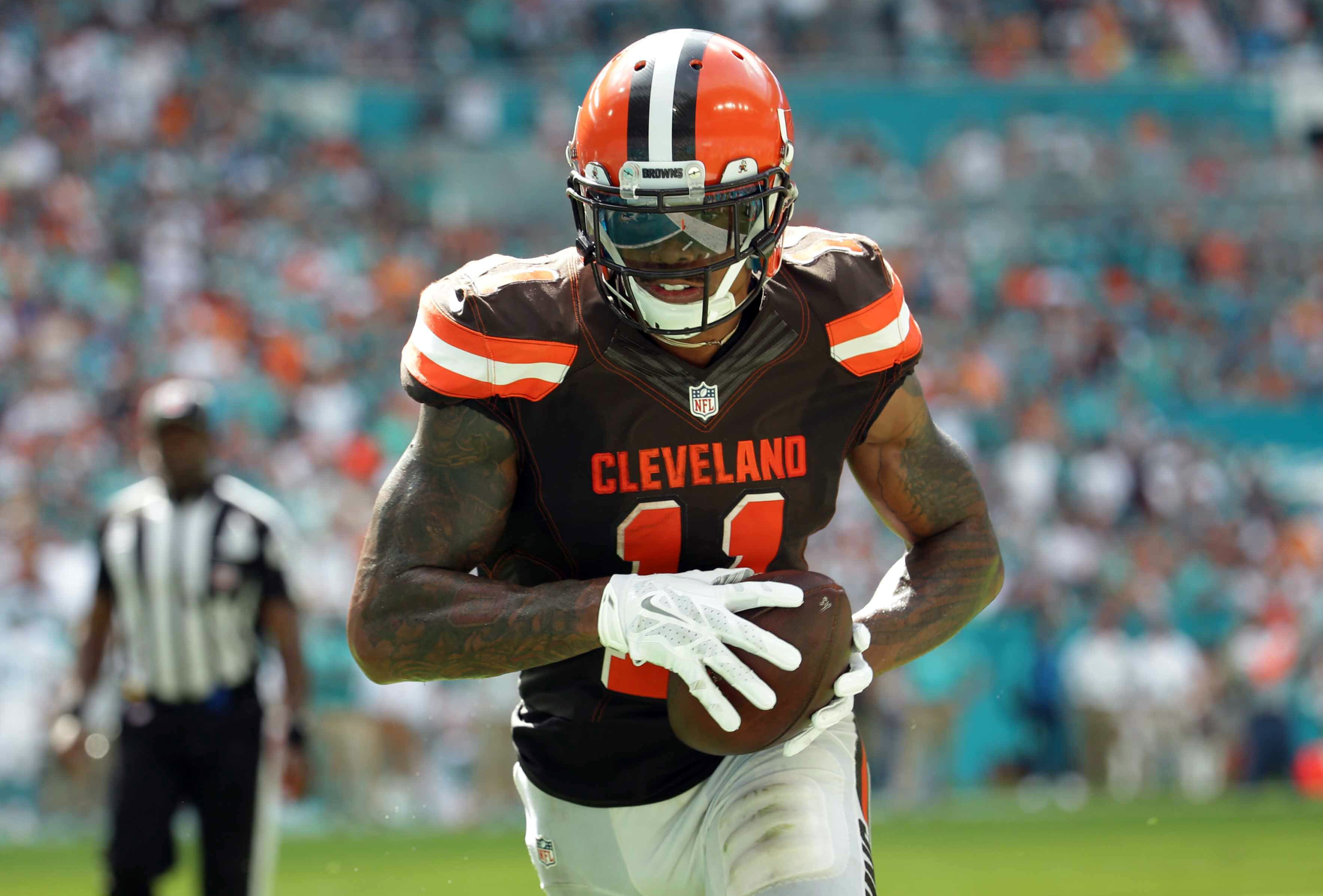 FILE - In this Sept. 25, 2016, file photo, Cleveland Browns wide receiver Terrelle Pryor (11) eyes the goal  line as he heads in for a touchdown during the second half of an NFL football game against the Miami Dolphins in Miami Gardens, Fla. Fantasy footb