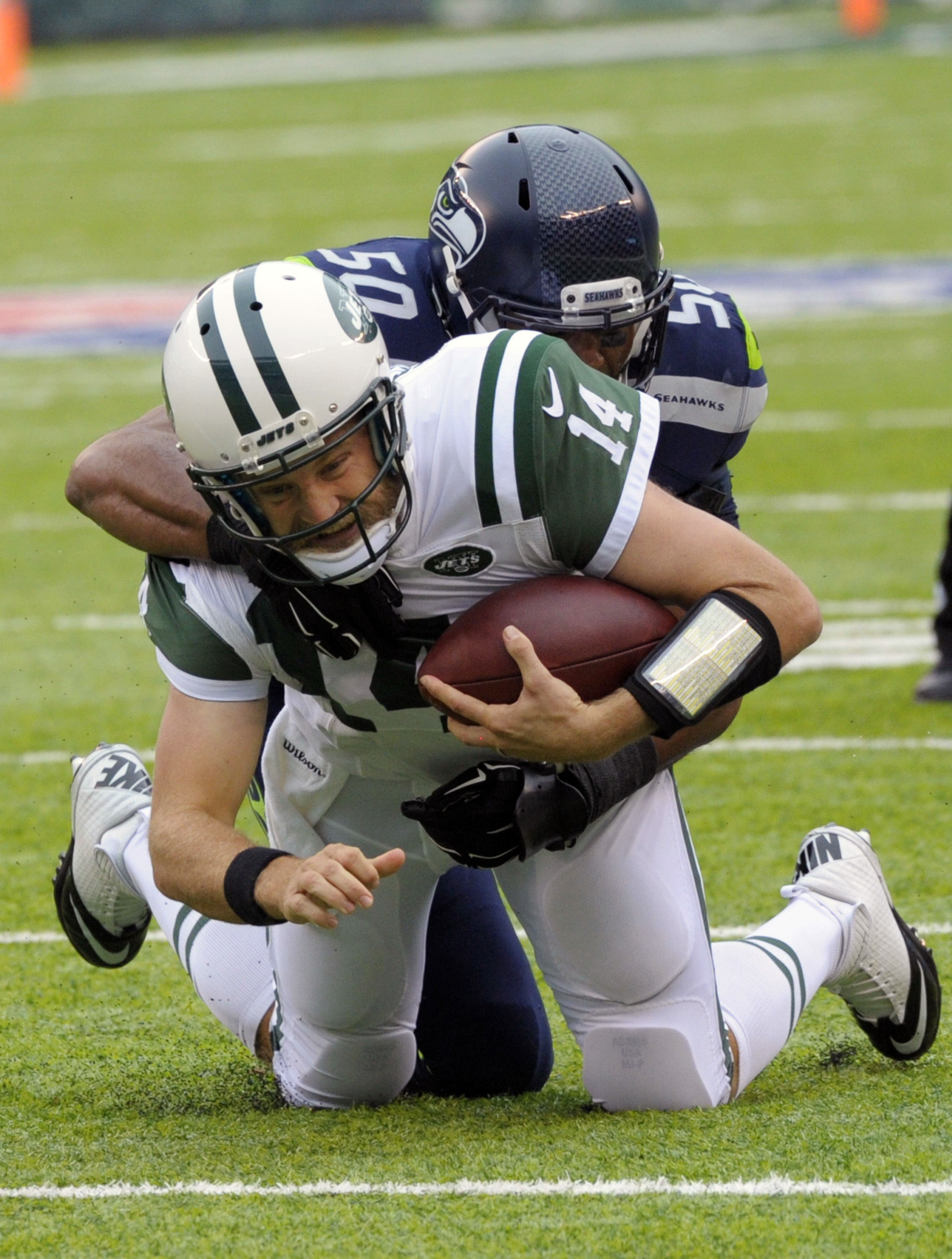 New York Jets quarterback Ryan Fitzpatrick (14) is tackled by Seattle Seahawks' K.J. Wright (50) during the first half of an NFL football game Sunday, Oct. 2, 2016, in East Rutherford, N.J.  (AP Photo/Bill Kostroun)