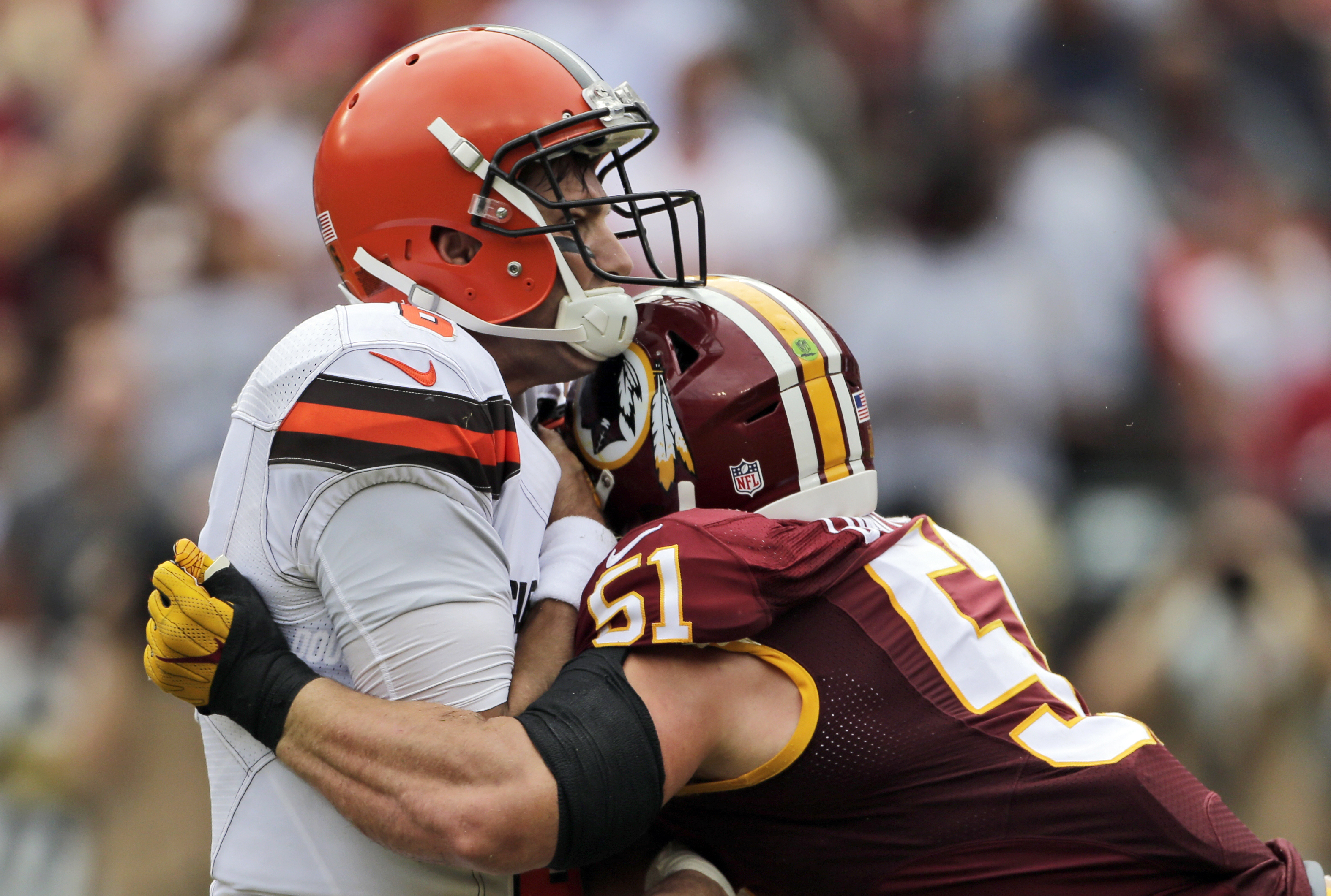 Cleveland Browns quarterback Cody Kessler (6) is hit by Washington Redskins inside linebacker Will Compton (51) after he threw a touchdown pass during the first half of an NFL football game Sunday, Oct. 2, 2016, in Landover, Md. (AP Photo/Mark Tenally)