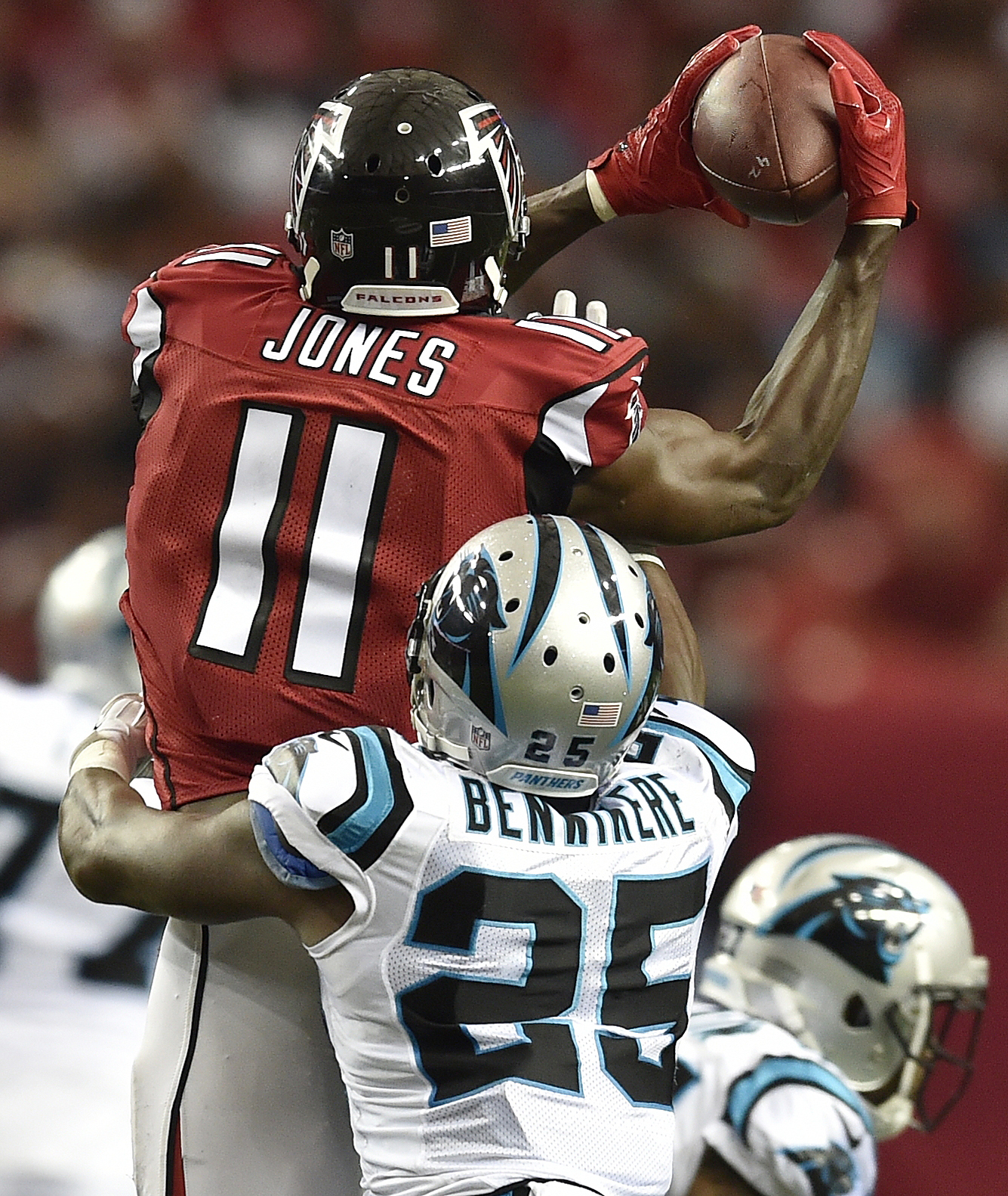 Atlanta Falcons wide receiver Julio Jones (11) makes the catch against Carolina Panthers cornerback Bene' Benwikere (25) during the second half of an NFL football game, Sunday, Oct. 2, 2016, in Atlanta. (AP Photo/Rainier Ehrhardt)