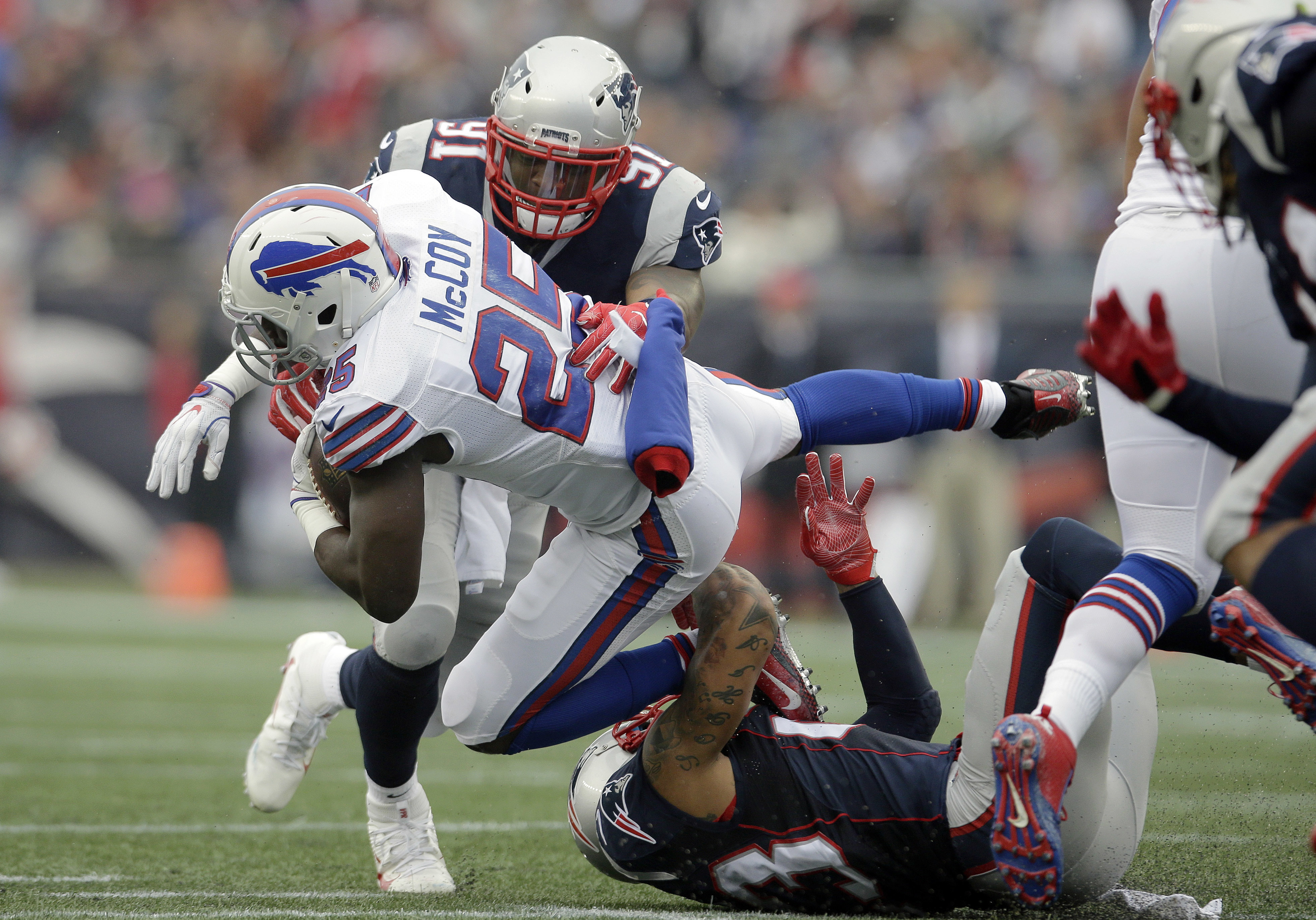 New England Patriots linebacker Jamie Collins (91) and safety Patrick Chung, below, tackle Buffalo Bills running back LeSean McCoy (25) during the first half of an NFL football game Sunday, Oct. 2, 2016, in Foxborough, Mass. (AP Photo/Steven Senne)