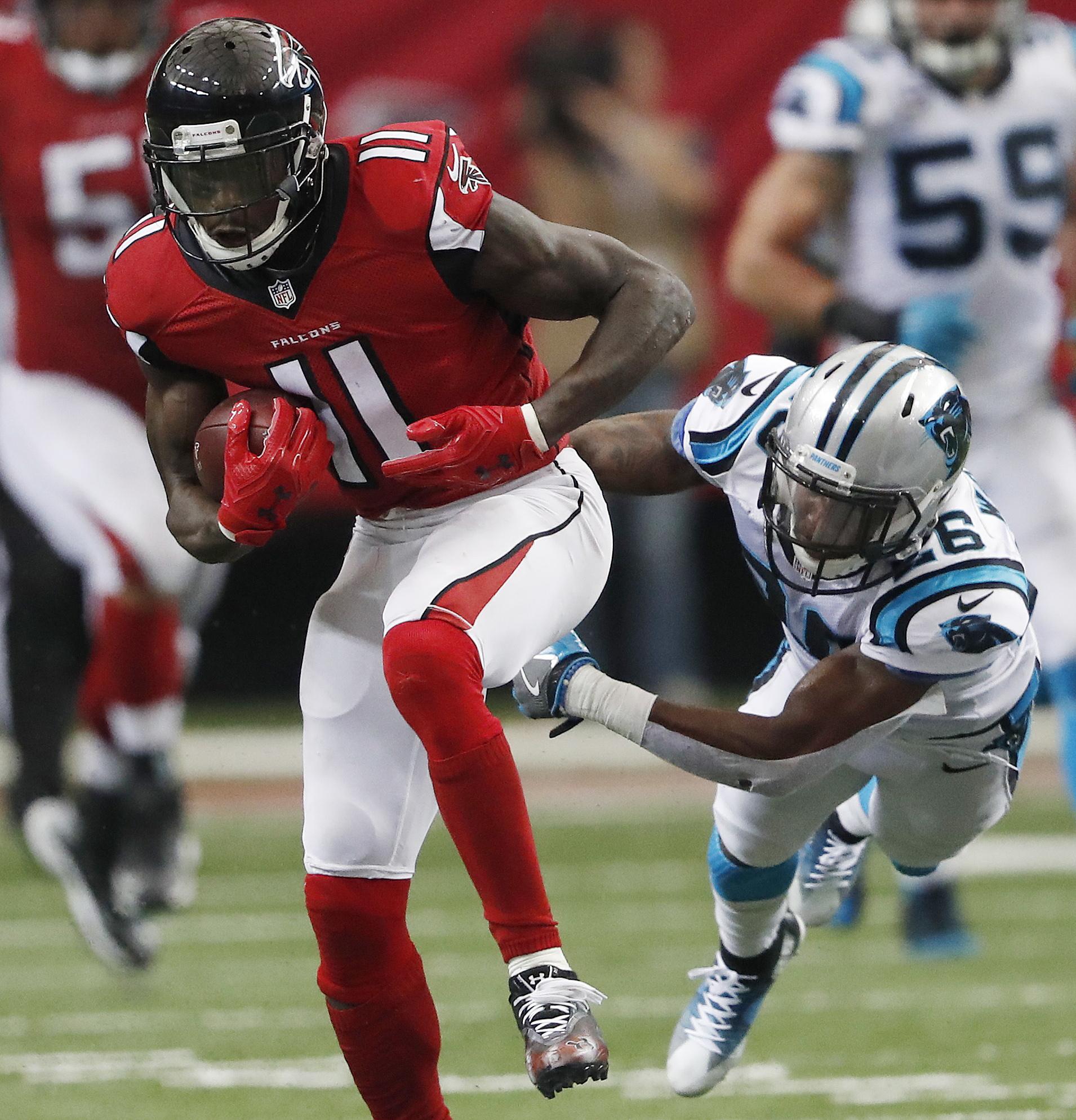 Atlanta Falcons wide receiver Julio Jones (11) runs past Carolina Panthers cornerback Daryl Worley (26) during the second half of an NFL football game, Sunday, Oct. 2, 2016, in Atlanta.  (AP Photo/John Bazemore)
