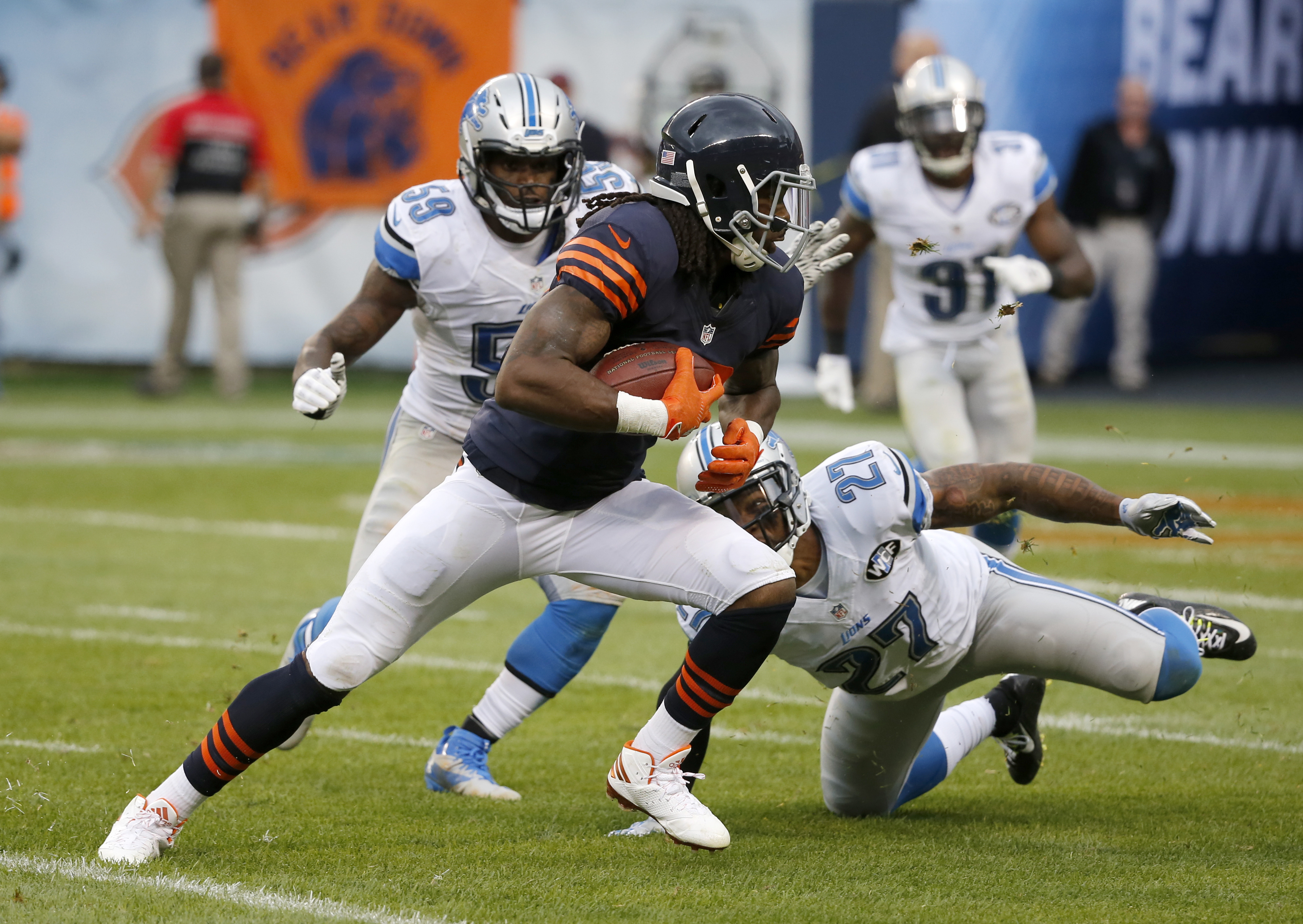 Chicago Bears wide receiver Kevin White (13) runs after receiving a pass against Detroit Lions free safety Glover Quin (27) during the second half of an NFL football game, Sunday, Oct. 2, 2016, in Chicago. (AP Photo/Charles Rex Arbogast)