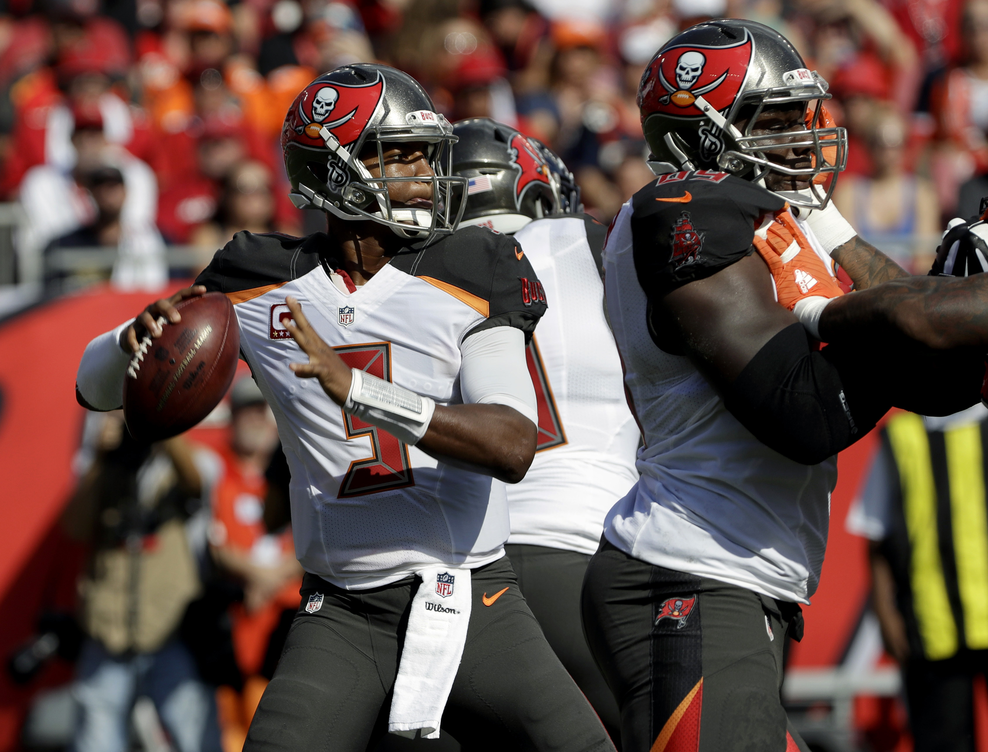 Tampa Bay Buccaneers quarterback Jameis Winston (3) throws a pass that eventually intercepted by Denver Broncos cornerback Aqib Talib during the first quarter of an NFL football game Sunday, Oct. 2, 2016, in Tampa, Fla. (AP Photo/Chris O'Meara)