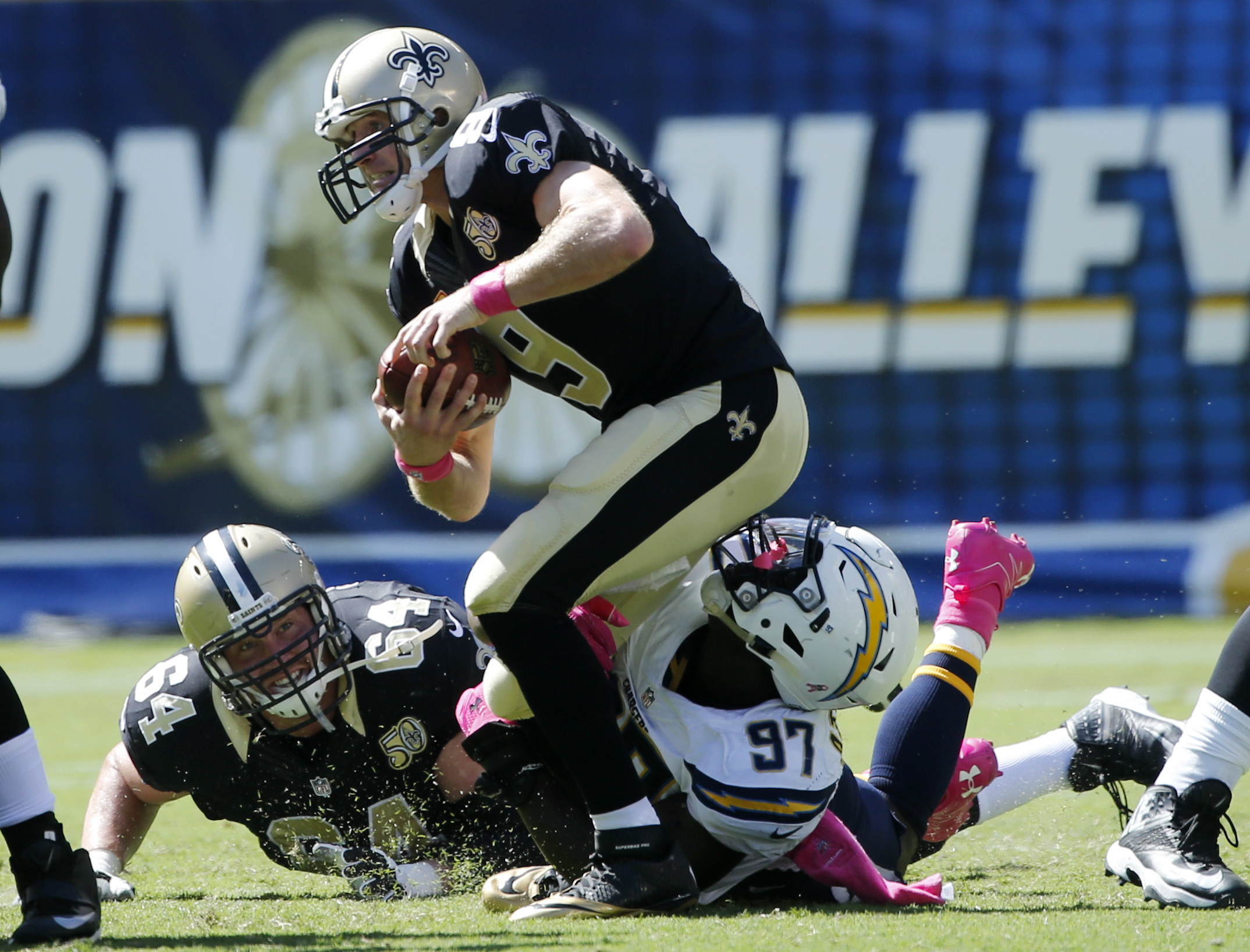 New Orleans Saints quarterback Drew Brees, top, is sacked by San Diego Chargers outside linebacker Jeremiah Attaochu (97) during the second half of an NFL football game Sunday, Oct. 2, 2016, in San Diego. (AP Photo/Lenny Ignelzi)