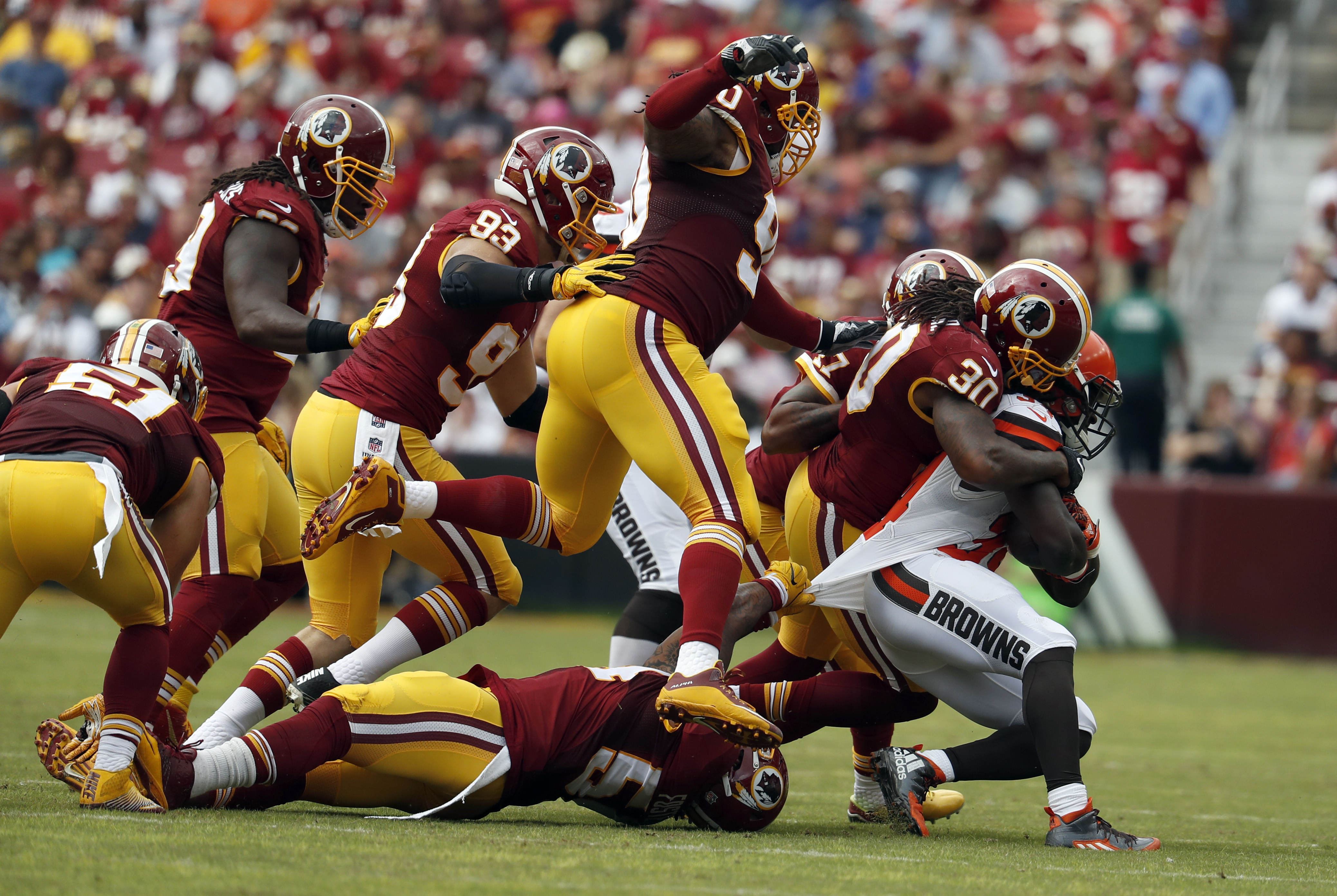 Cleveland Browns running back Isaiah Crowell (34) is tackled by Washington Redskins strong safety David Bruton (30) and others, during the first half of an NFL football game Sunday, Oct. 2, 2016, in Landover, Md. The Redskins won 31-20. (AP Photo/Carolyn