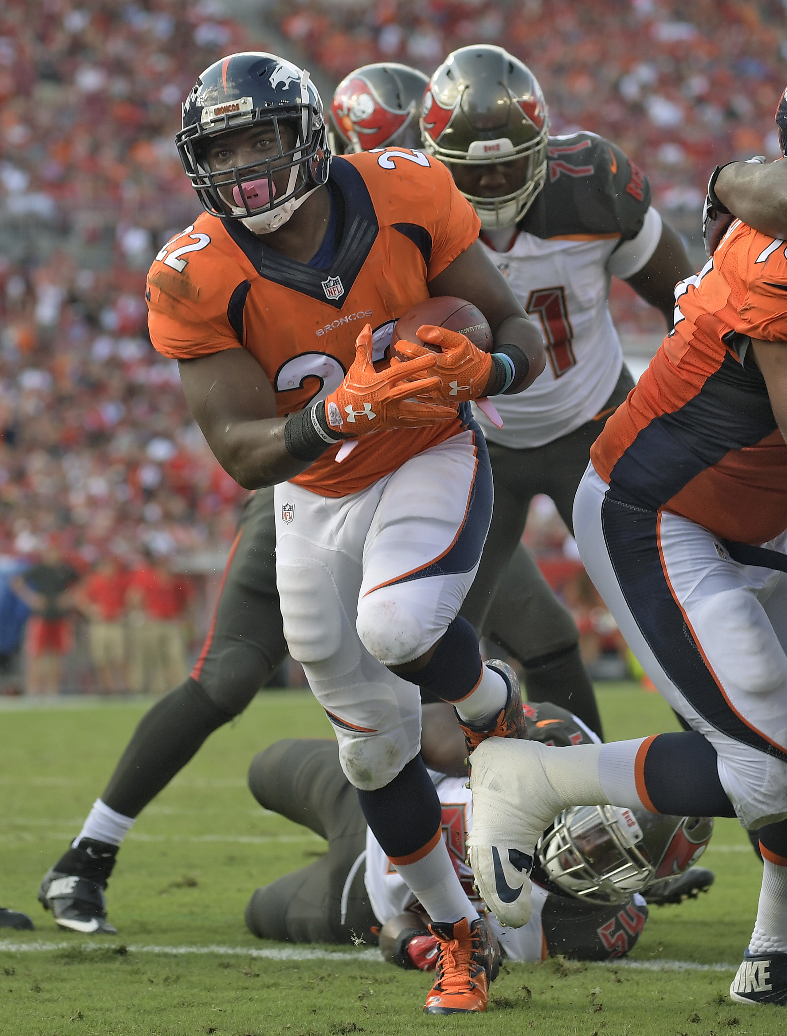 Denver Broncos running back C.J. Anderson (22) runs 1-yard for a touchdown run against the Tampa Bay Buccaneers during the second quarter of an NFL football game Sunday, Oct. 2, 2016, in Tampa, Fla. (AP Photo/Phelan Ebenhack)