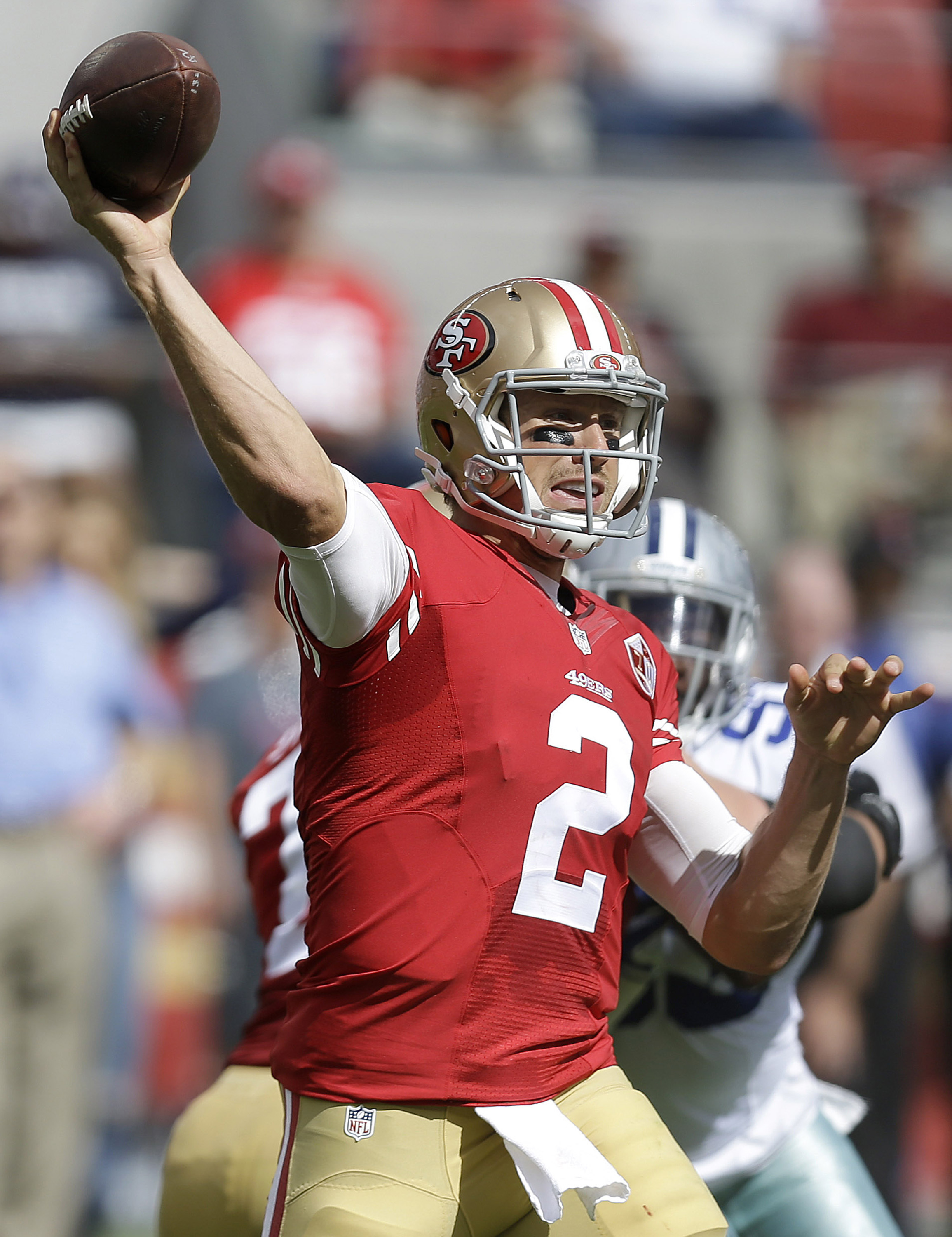 San Francisco 49ers quarterback Blaine Gabbert (2) passes against the Dallas Cowboys during the first half of an NFL football game in Santa Clara, Calif., Sunday, Oct. 2, 2016. (AP Photo/Ben Margot)