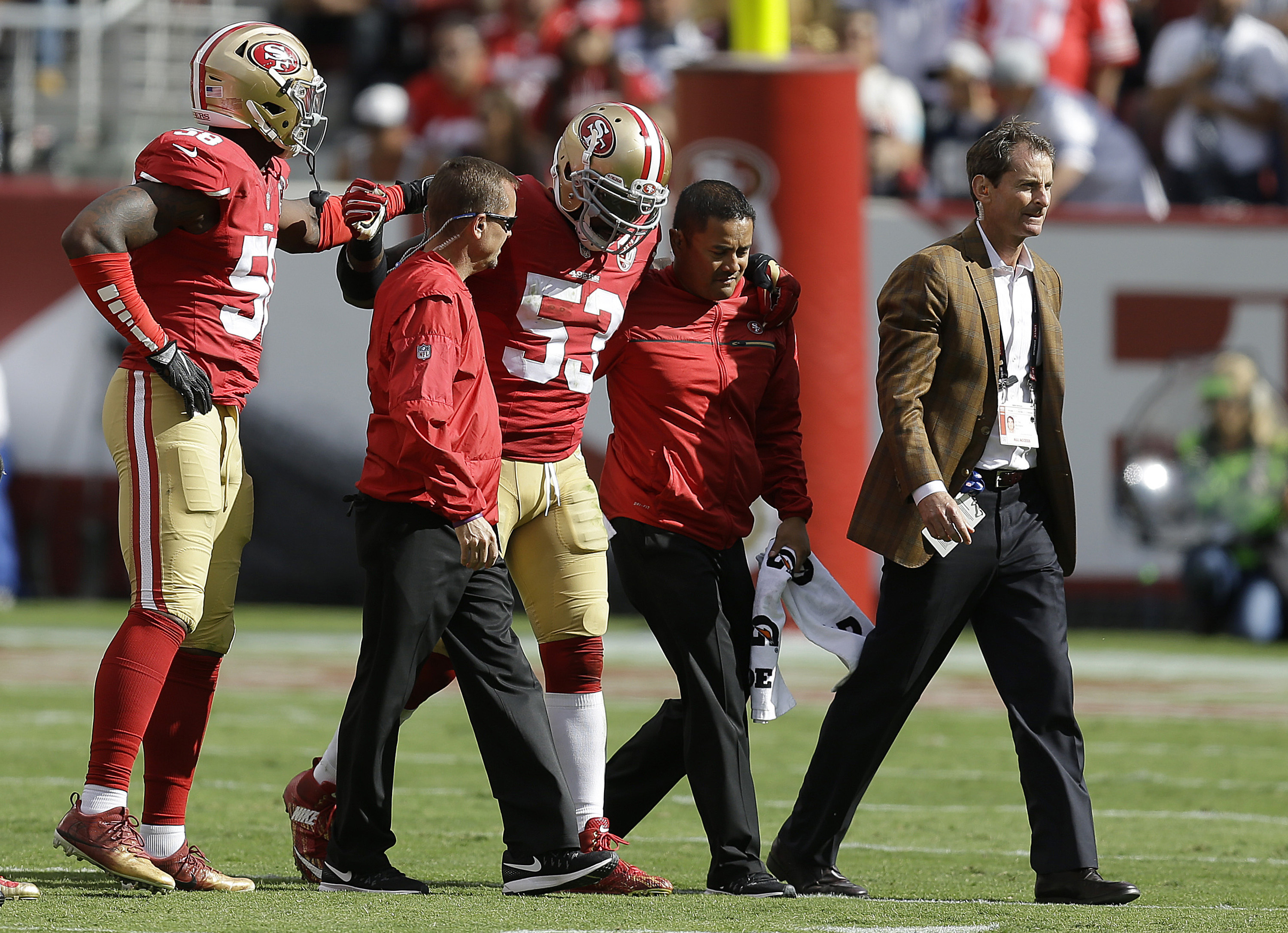 San Francisco 49ers linebacker NaVorro Bowman (53) is helped off the field during the second half of an NFL football game against the Dallas Cowboys in Santa Clara, Calif., Sunday, Oct. 2, 2016. (AP Photo/Ben Margot)