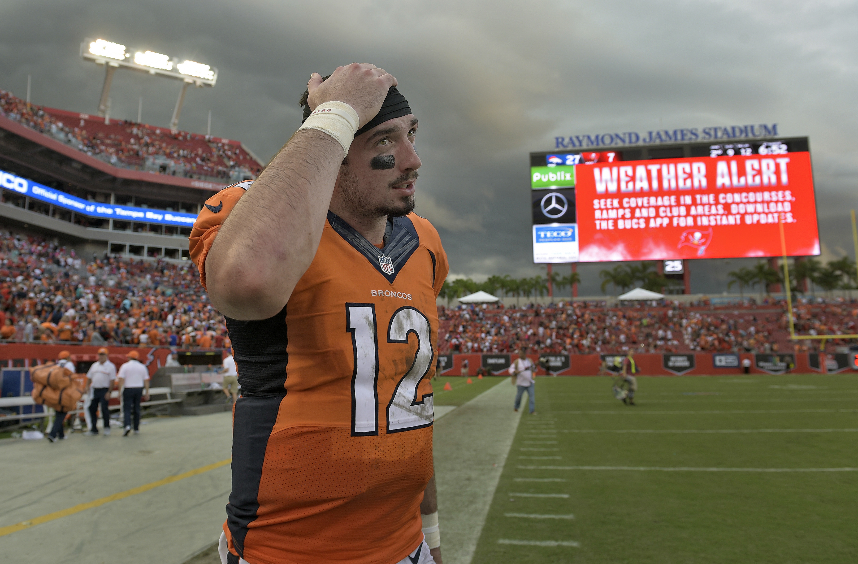 Denver Broncos quarterback Paxton Lynch (12) heads for the locker room during a weather delay in the fourth quarter of an NFL football game against the Tampa Bay Buccaneers Sunday, Oct. 2, 2016, in Tampa, Fla. (AP Photo/Phelan M. Ebenhack)