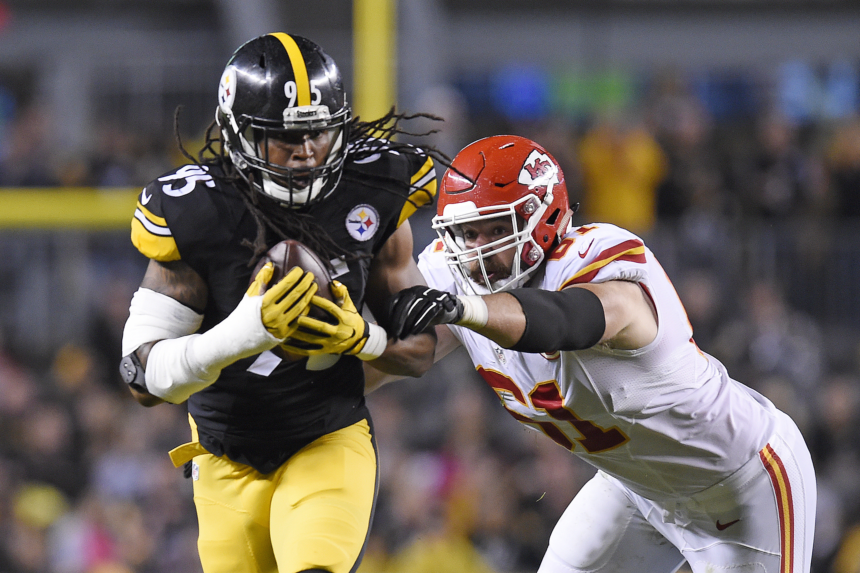 Pittsburgh Steelers outside linebacker Jarvis Jones (95) runs with an intercepted pass past Kansas City Chiefs center Mitch Morse (61) in the first half of an NFL football game in Pittsburgh, Sunday, Oct. 2, 2016. (AP Photo/Don Wright)