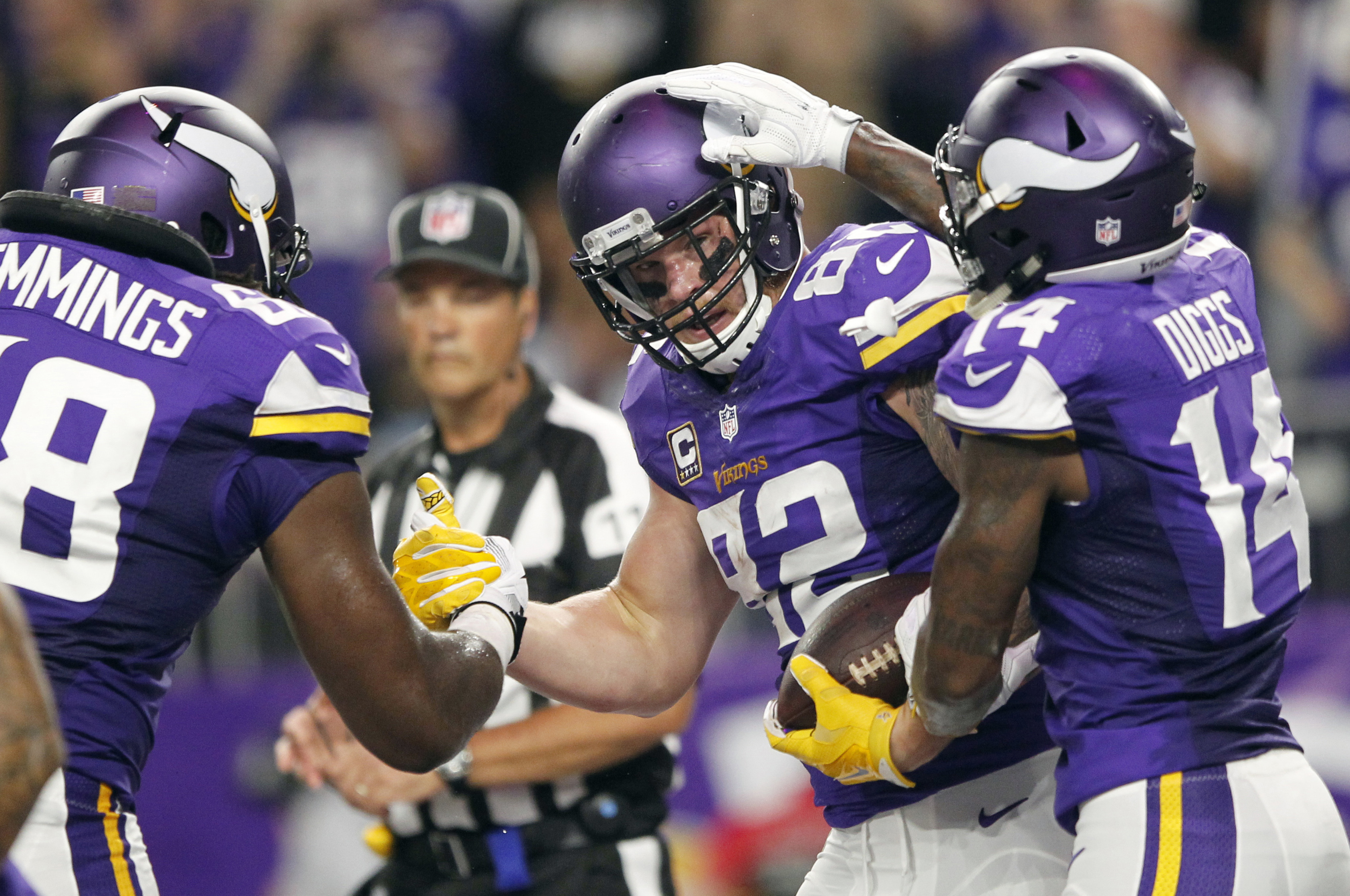 Minnesota Vikings tight end Kyle Rudolph, center, celebrates with teammates T.J. Clemmings, left, and Stefon Diggs, right, after catching a 7-yard touchdown pass during the first half of an NFL football game against the New York Giants on Monday, Oct. 3,
