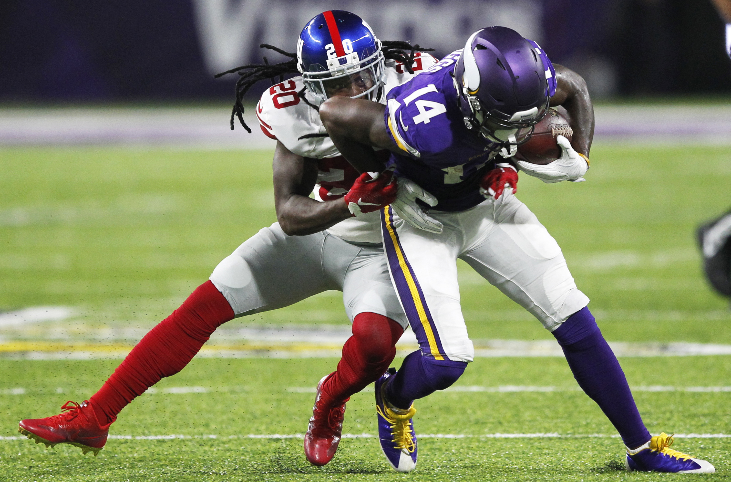 Minnesota Vikings wide receiver Stefon Diggs (14) tries to break a tackle by New York Giants cornerback Janoris Jenkins, left, after making a reception during the second half of an NFL football game, Monday, Oct. 3, 2016, in Minneapolis. (AP Photo/Andy Cl